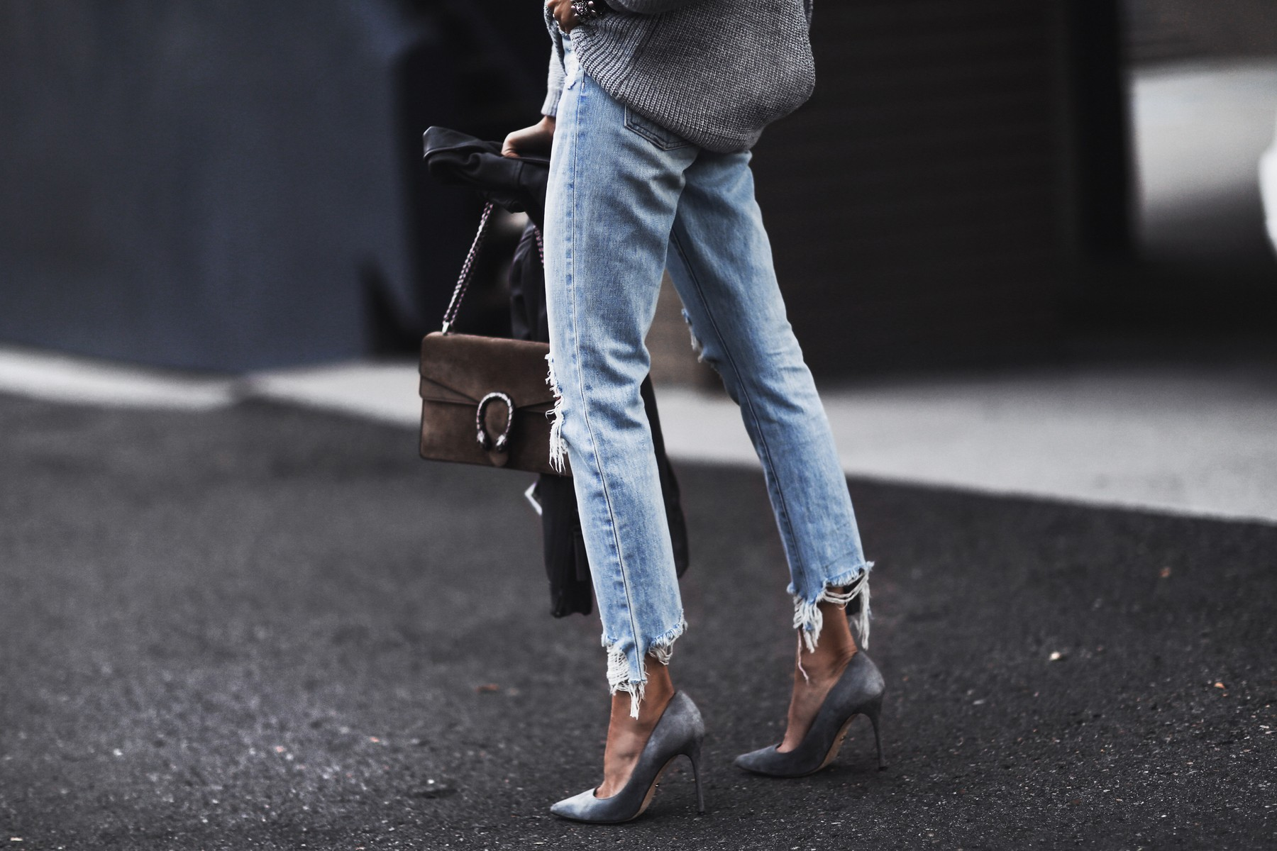 gray open back sweater, moto jacket, ripped boyfriend jeans, gray suede pumps, gucci bag