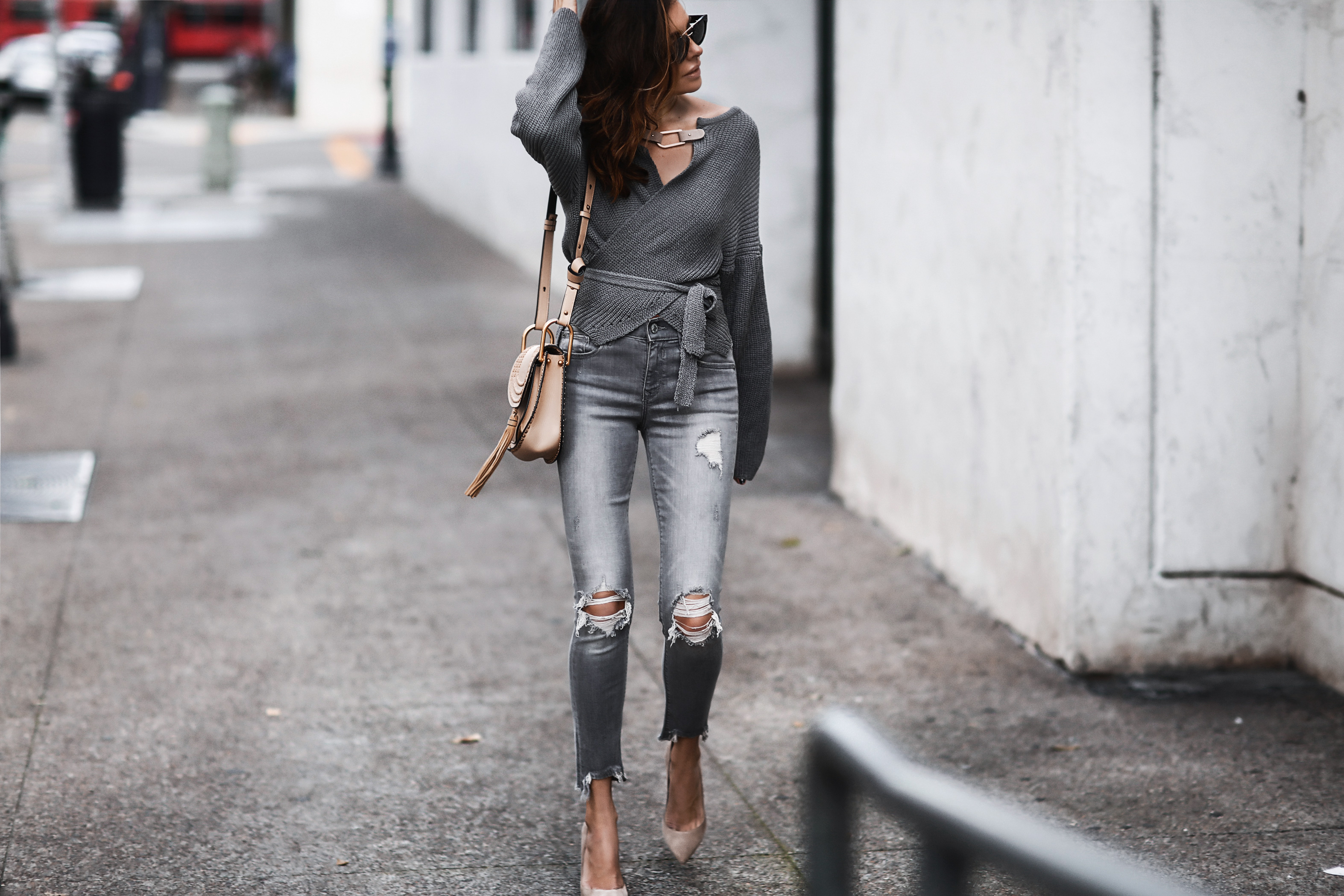 grey wrap sweater, grey ripped skinny jeans, nude suede pumps, chloe bag