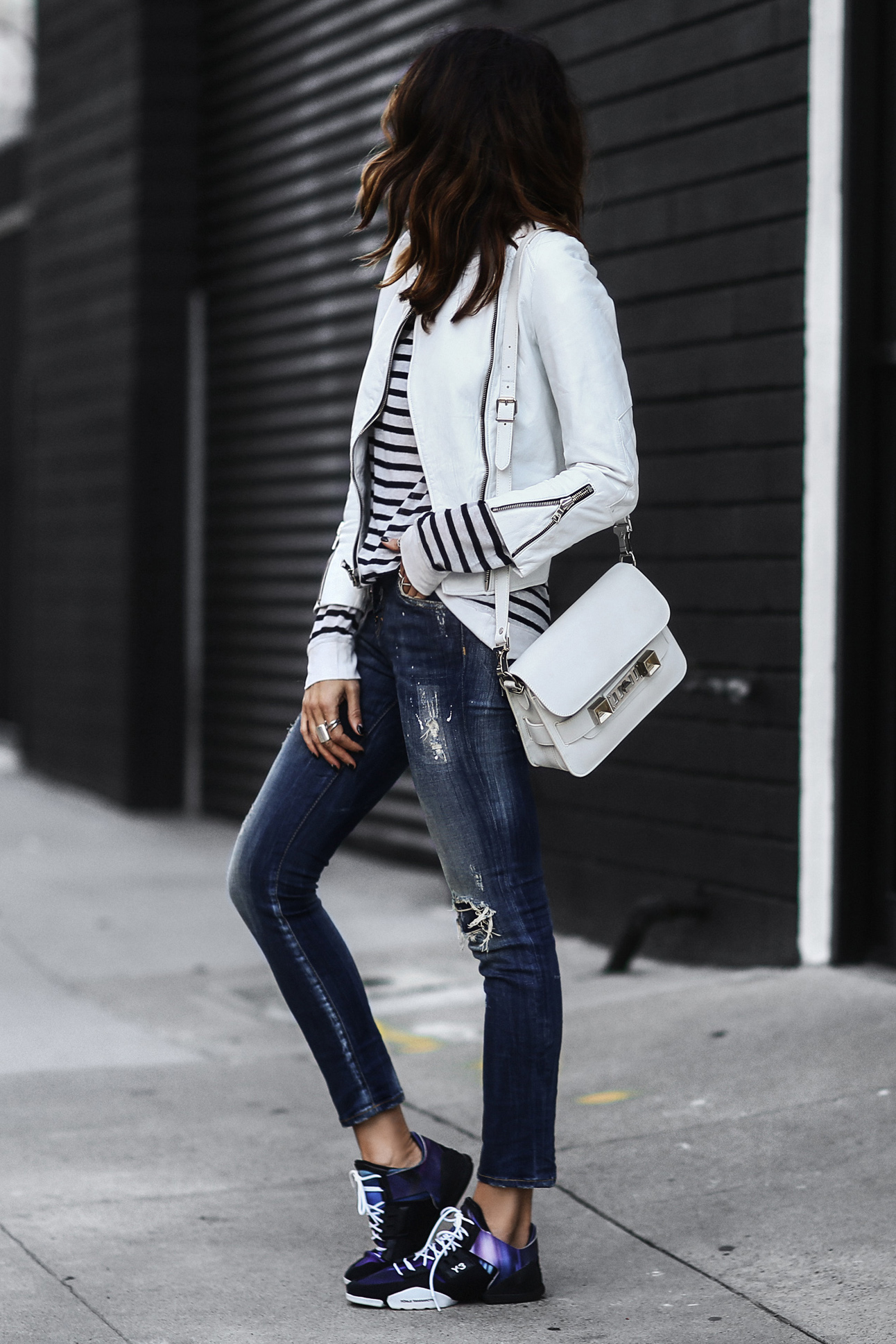 adidas sneakers, ripped skinny jeans, white leather jacket, striped shirt