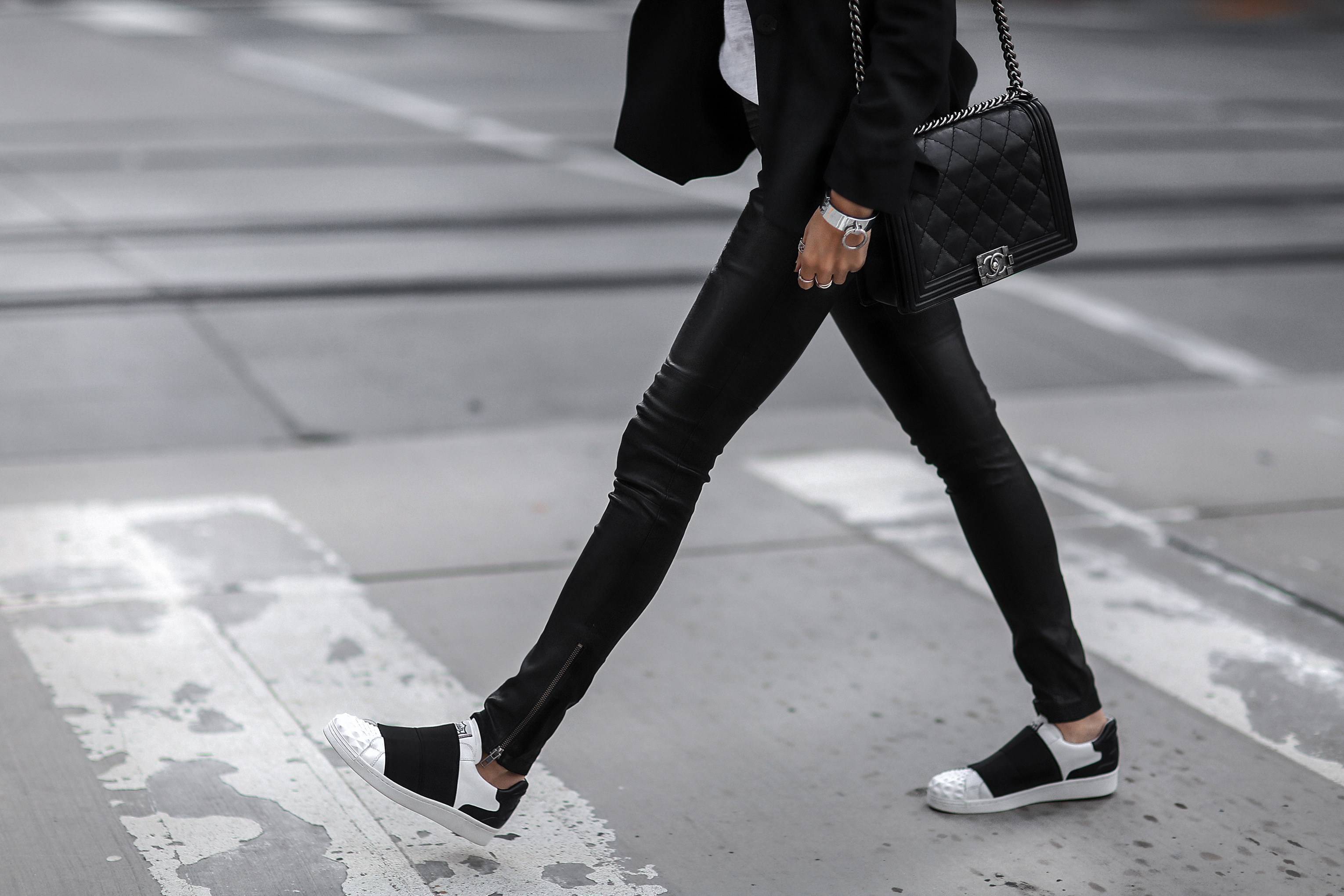 sneakers with elastic strap, black leather pants, blazer, chanel bag