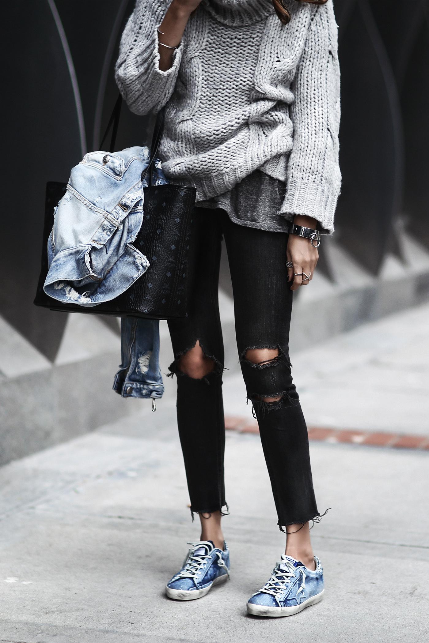 golden goose sneakers, black ripped jeans, oversized sweater, denim jacket