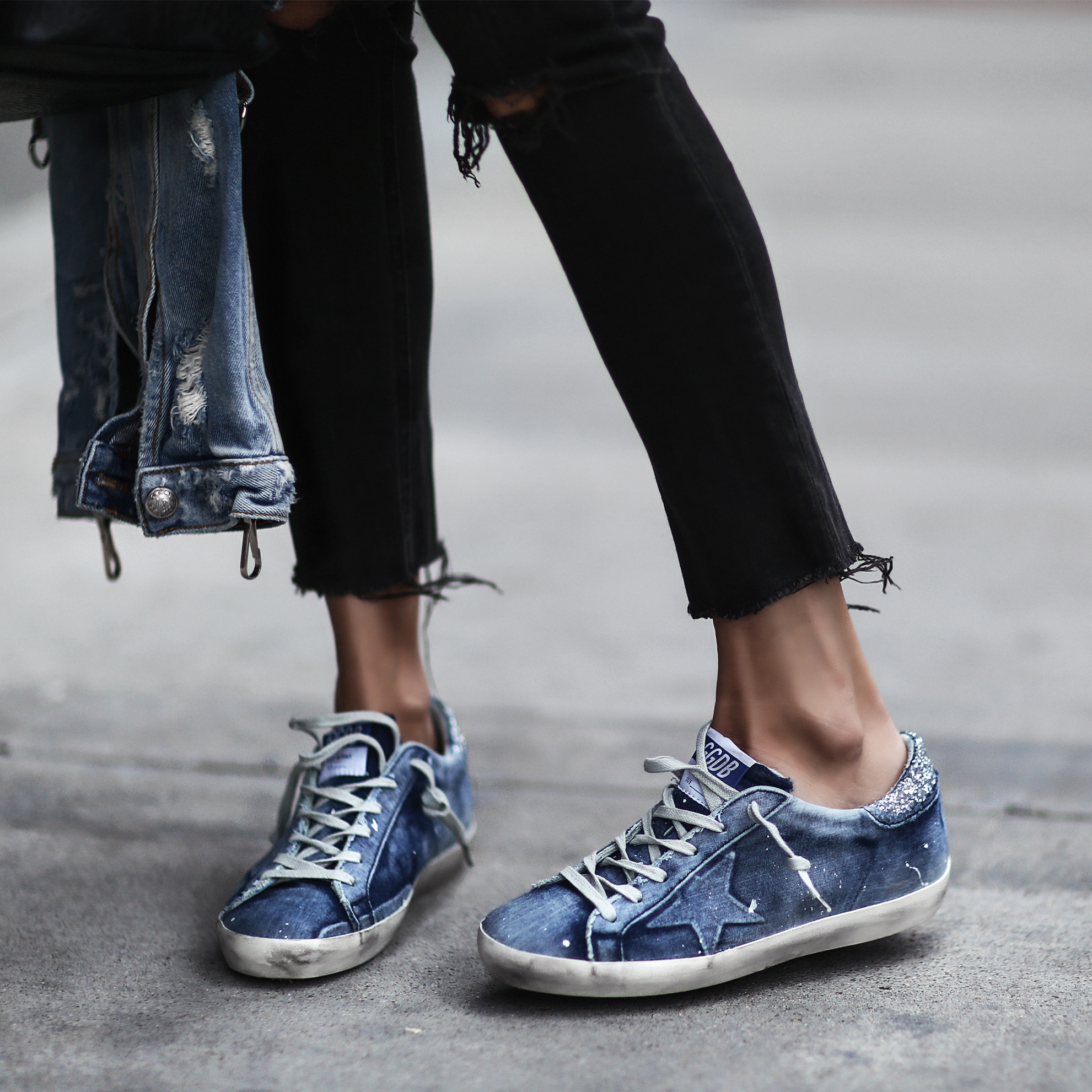 golden goose sneakers, black ripped skinny jeans, denim jacket