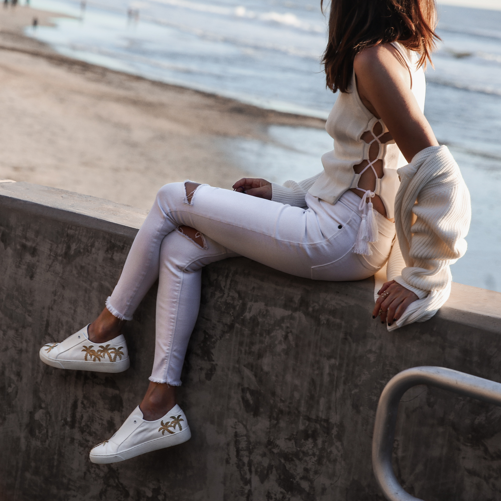 white sneakers with palm trees, white ripped skinny jeans, lace up tank top