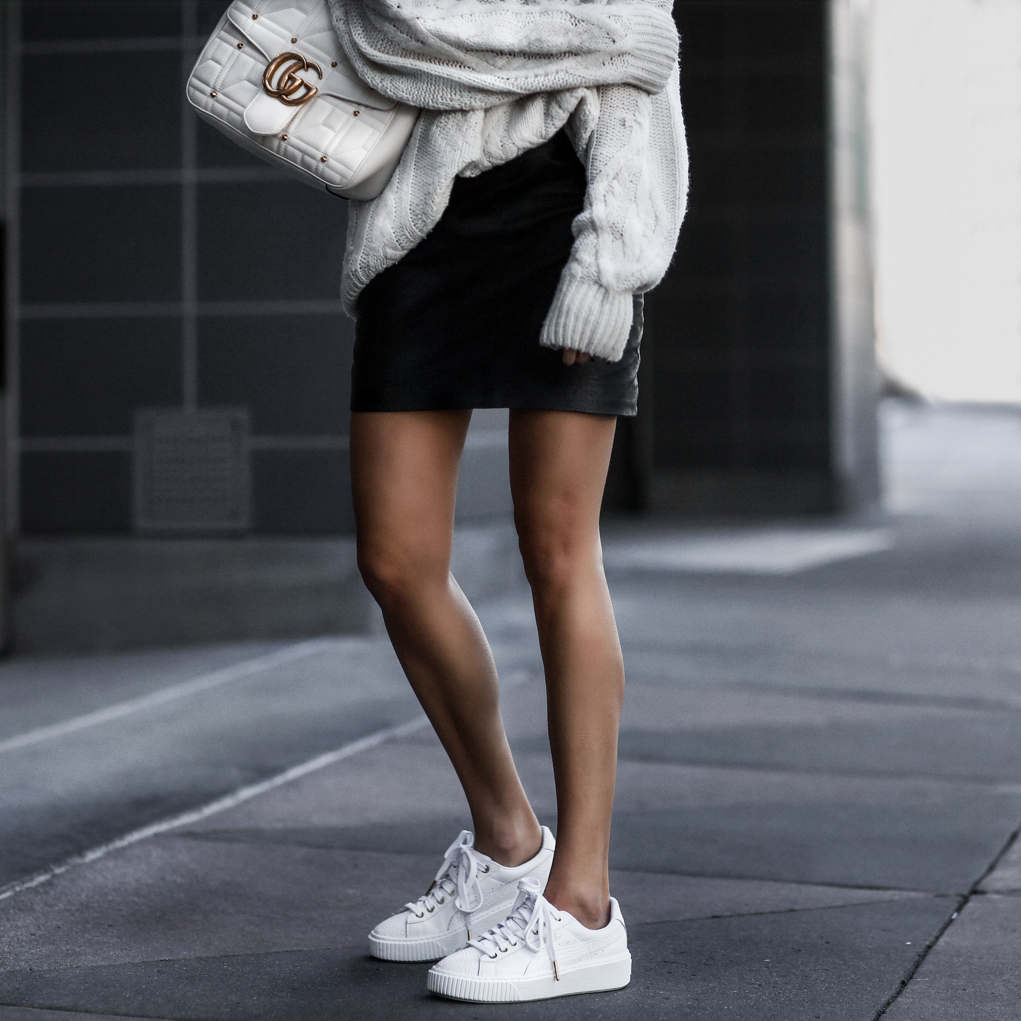 puma sneakers, leather skirt, oversized sweater, gucci bag