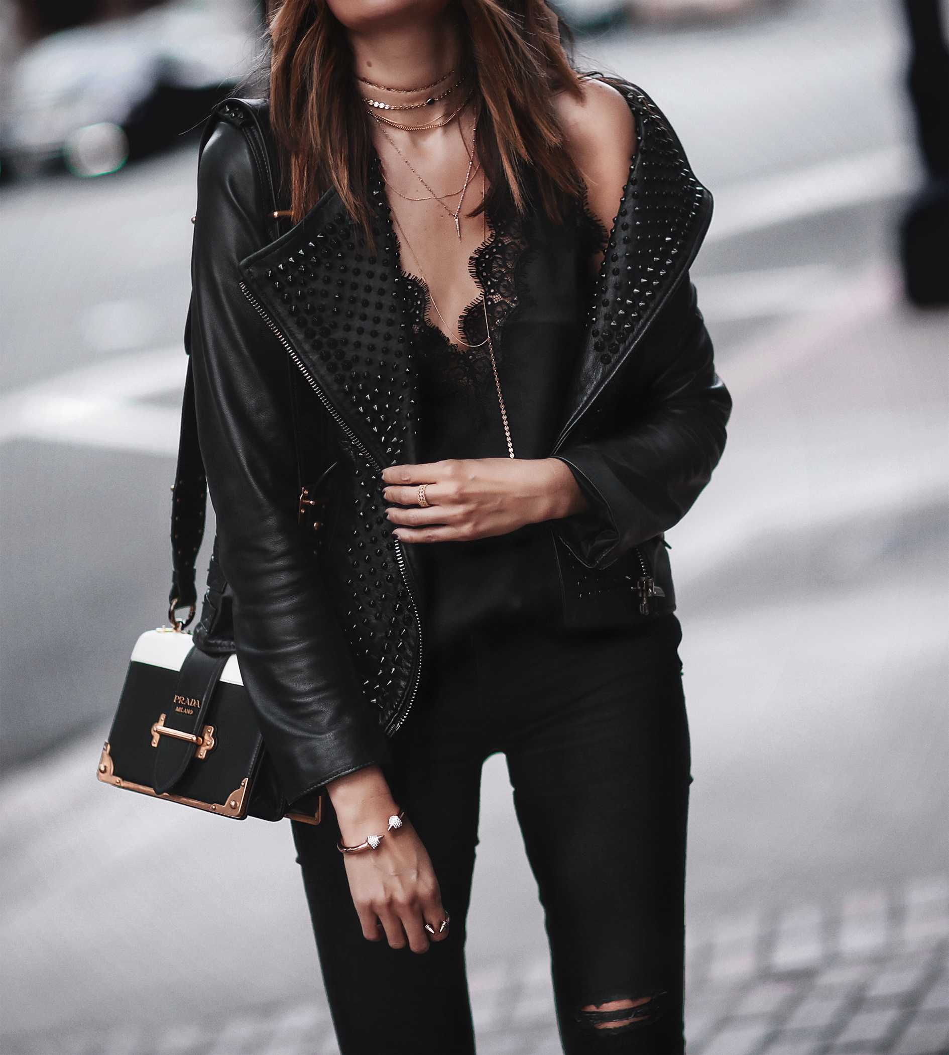 studded leather jacket, lace cami, layered chokers, prada bag