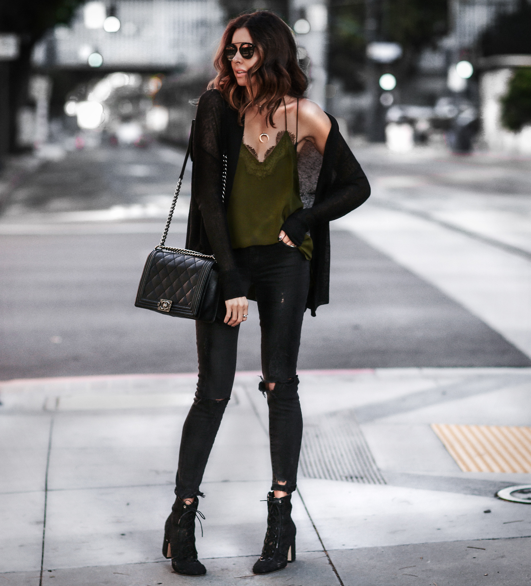 black cardigan, green lace cami, black ripped skinny jeans, lace up booties, chanel bag