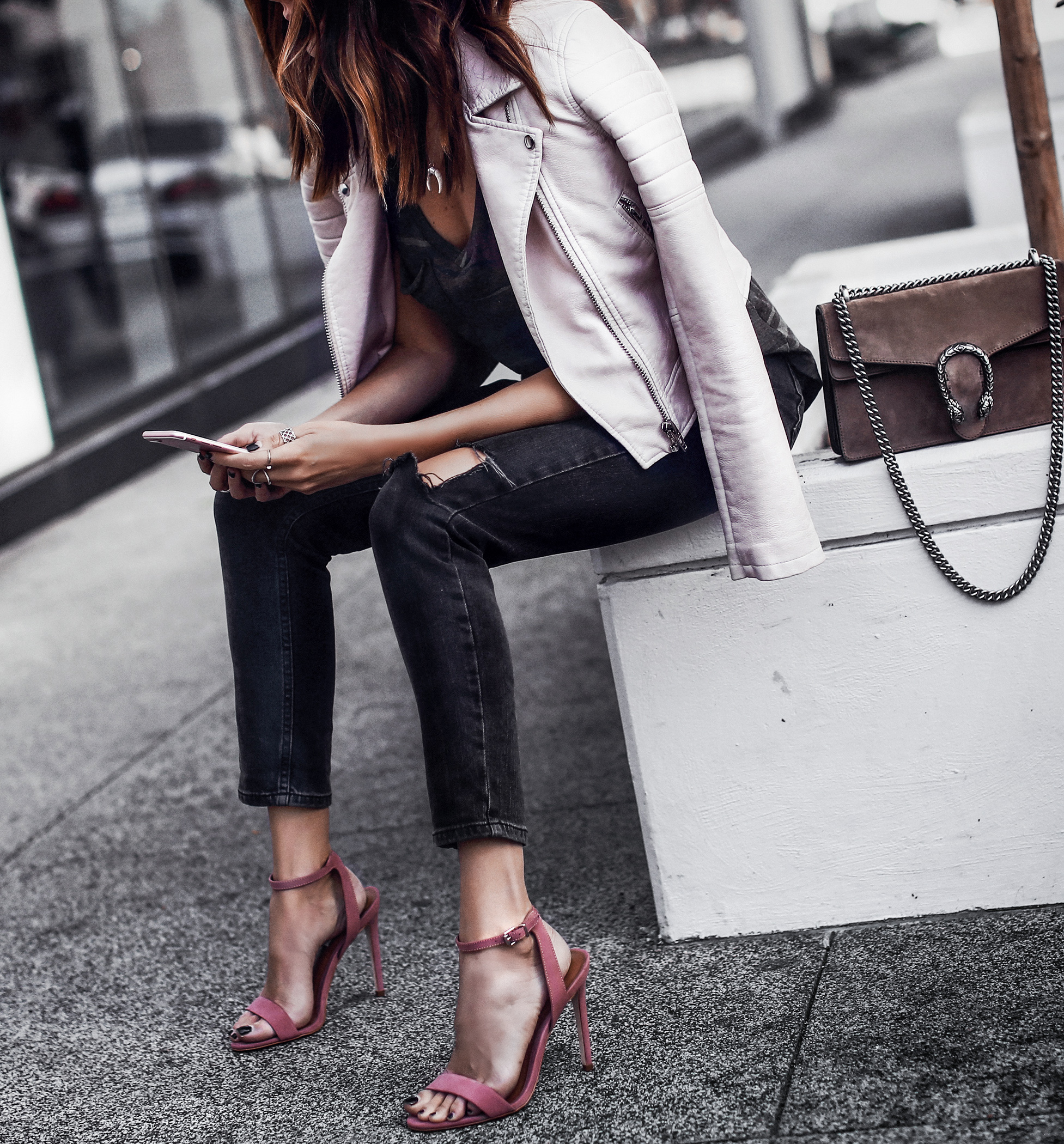 light pink leather jacket, camo tee, ripped black skinny jeans, blush heels, gucci bag