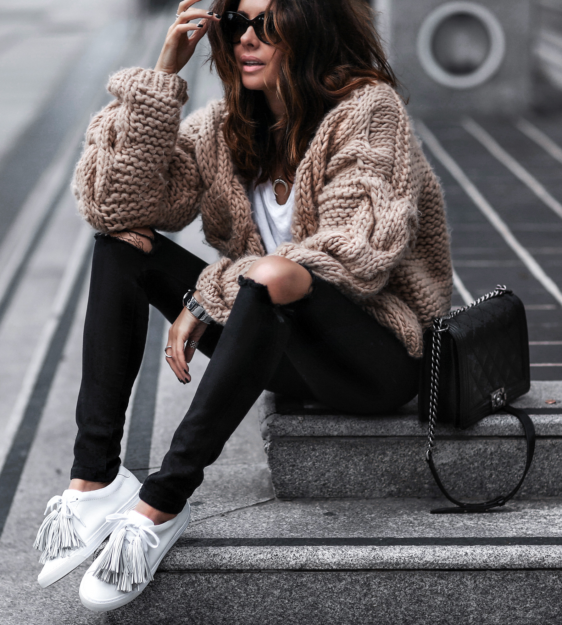 white sneakers with fringe, cable knit sweater, ripped black jeans, chanel bag