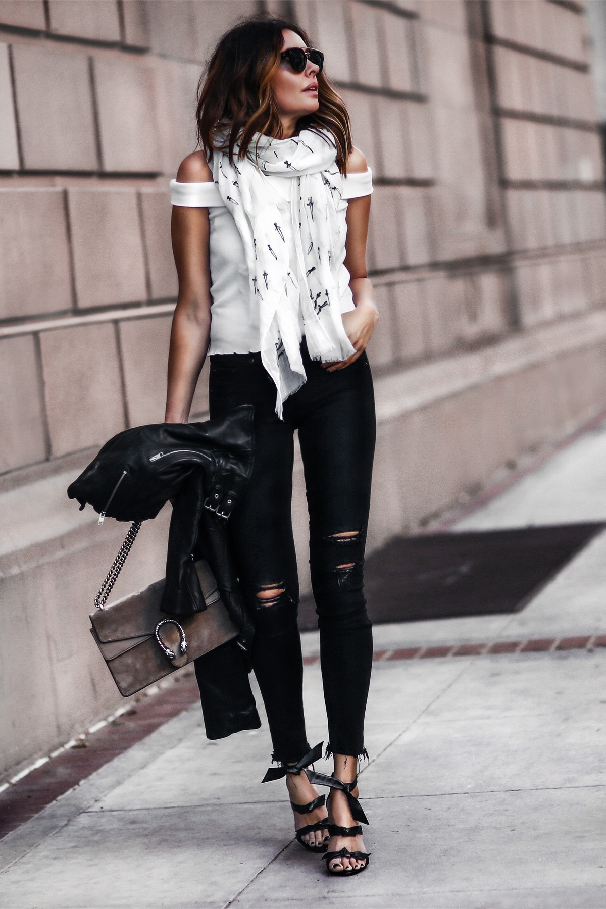 spring scarf, off the shoulder top, ripped black skinny jeans, black heels with bows, gucci bag