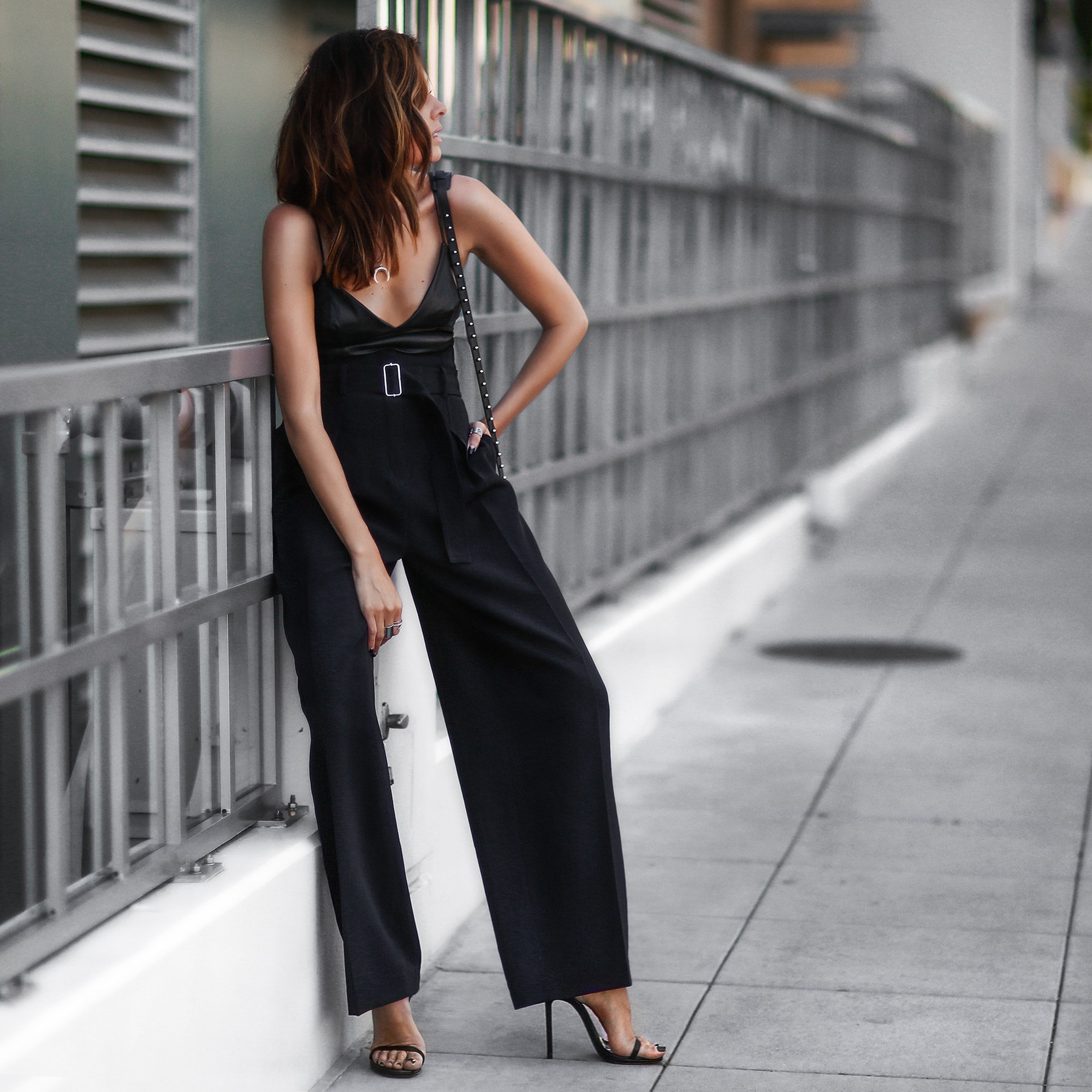 wide leg trousers, black crop top cami, studded bag