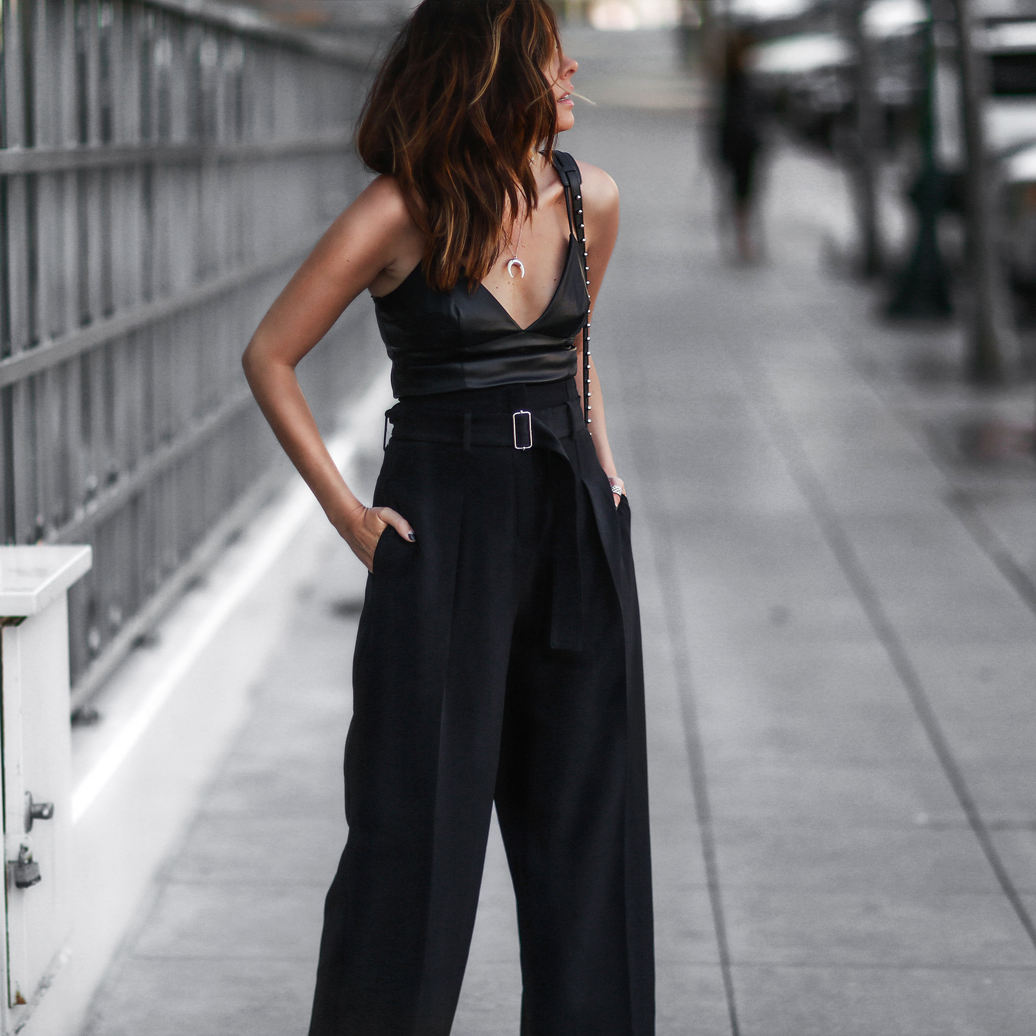 black wide leg trousers, black crop top cami, studded purse