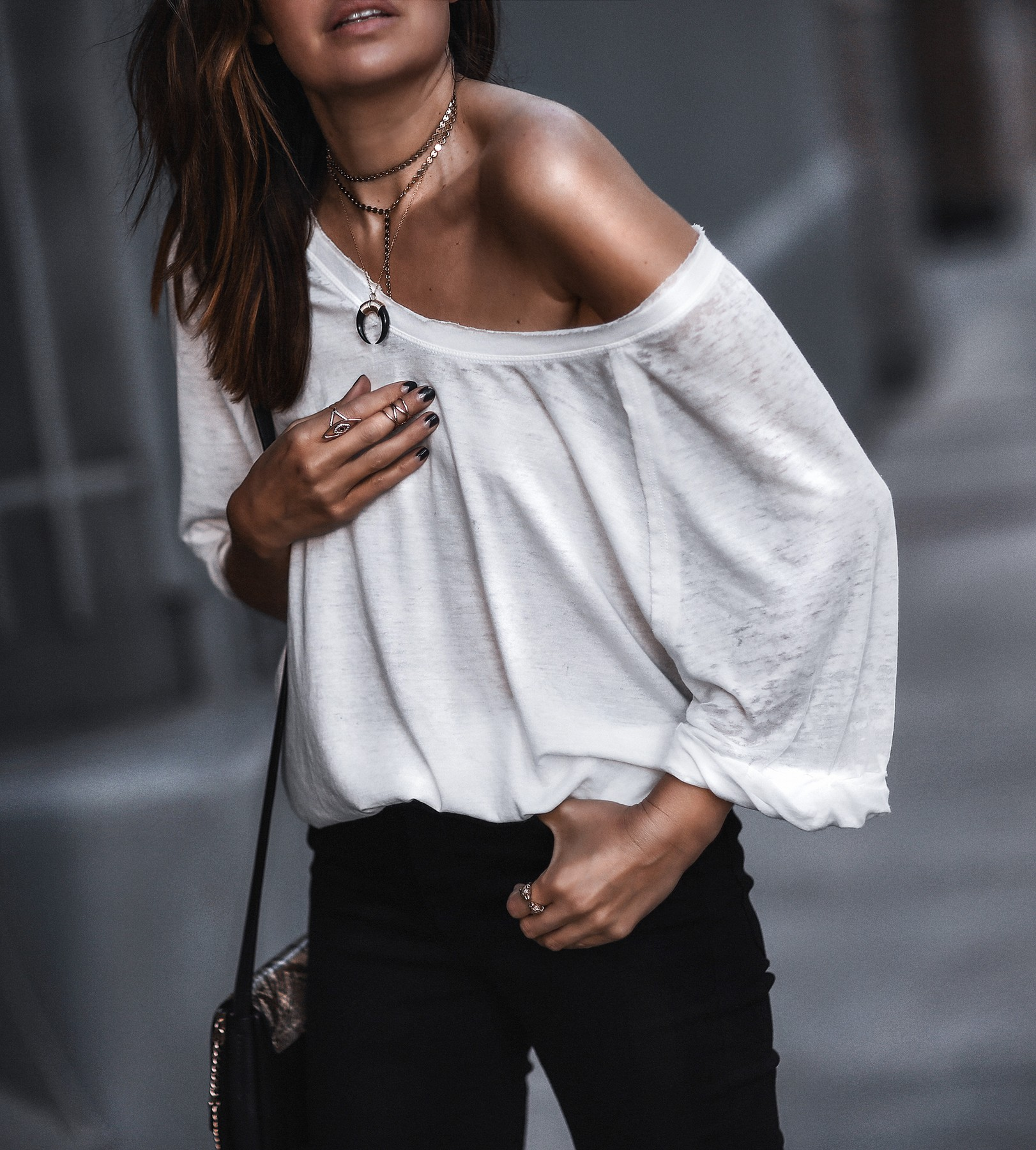 white oversized tee, raw hem jeans, nude heels, horn necklace, choker
