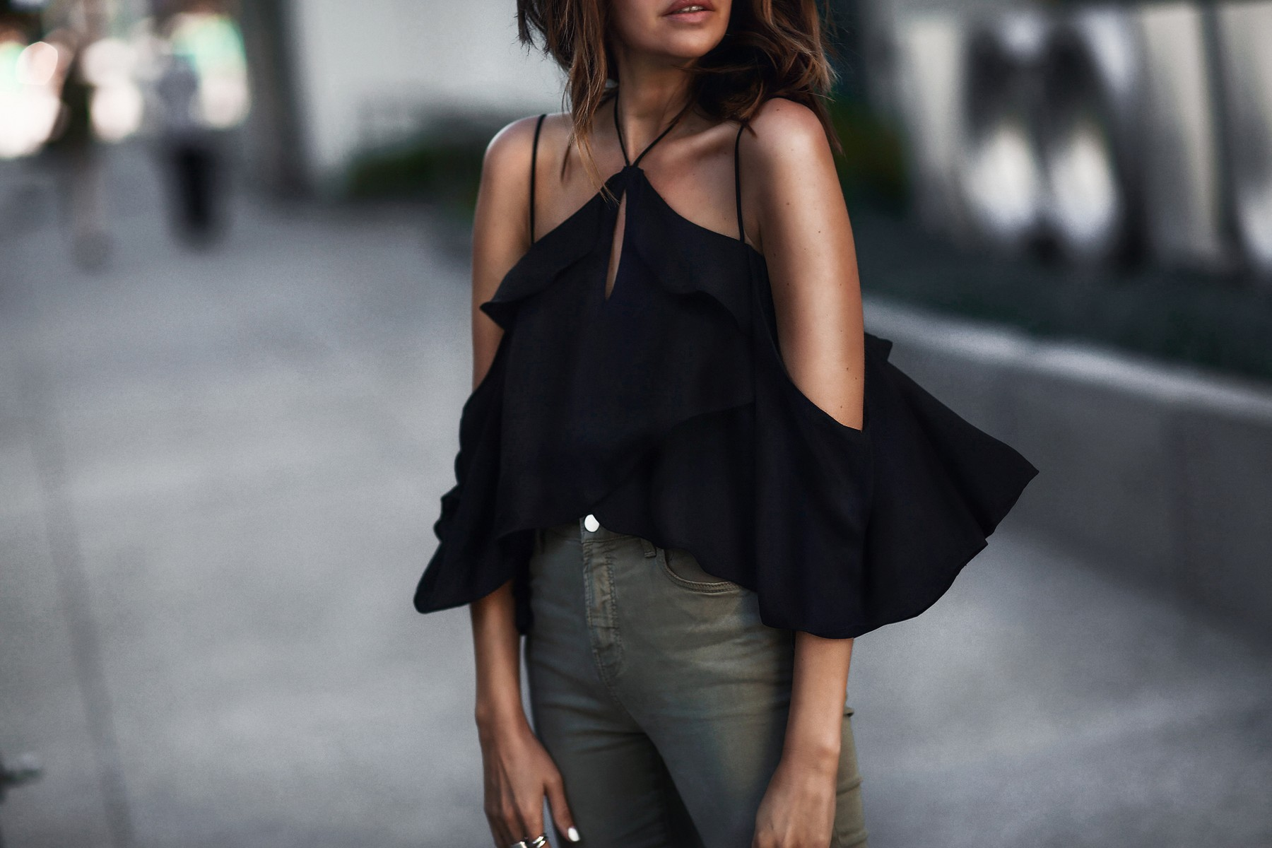 black ruffled cold shoulder top, army green skinny jeans