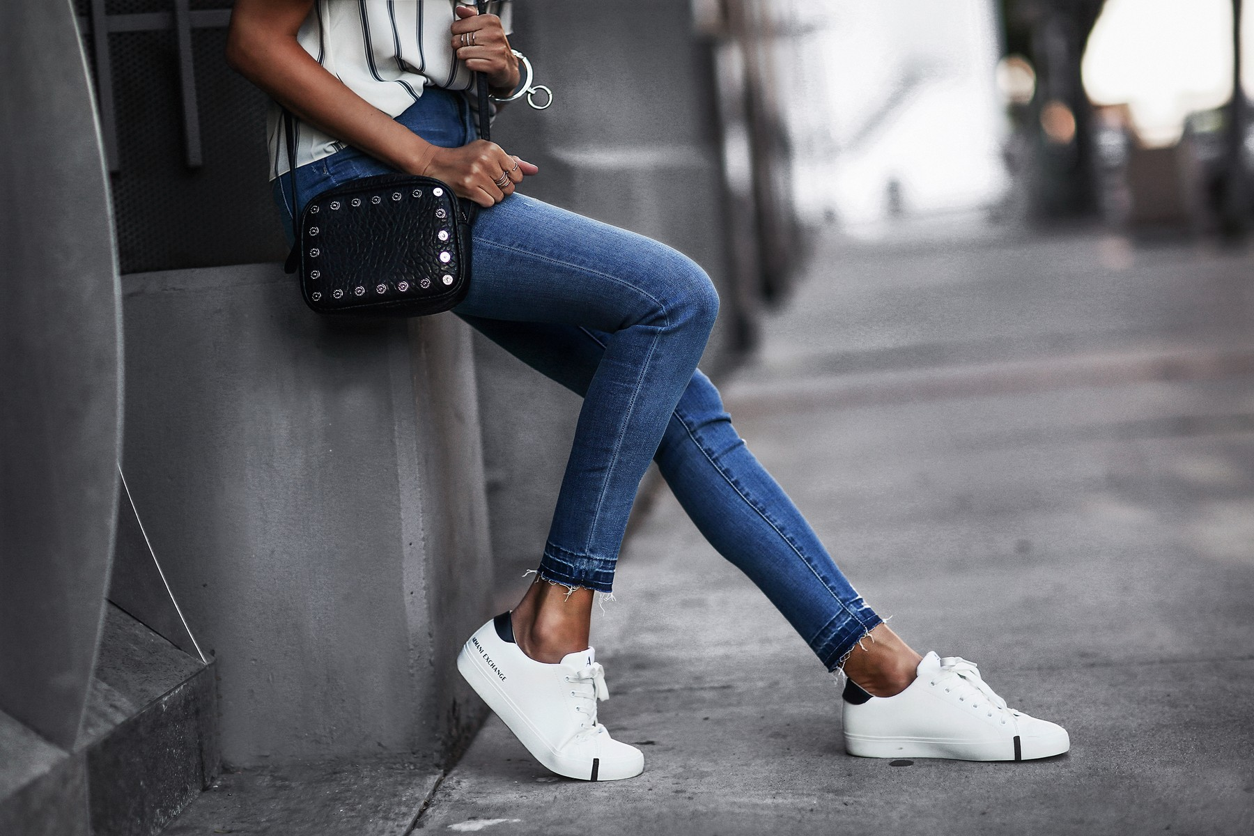 striped off the shoulder top, raw cuff skinny jeans, white sneakers, crossbody bag