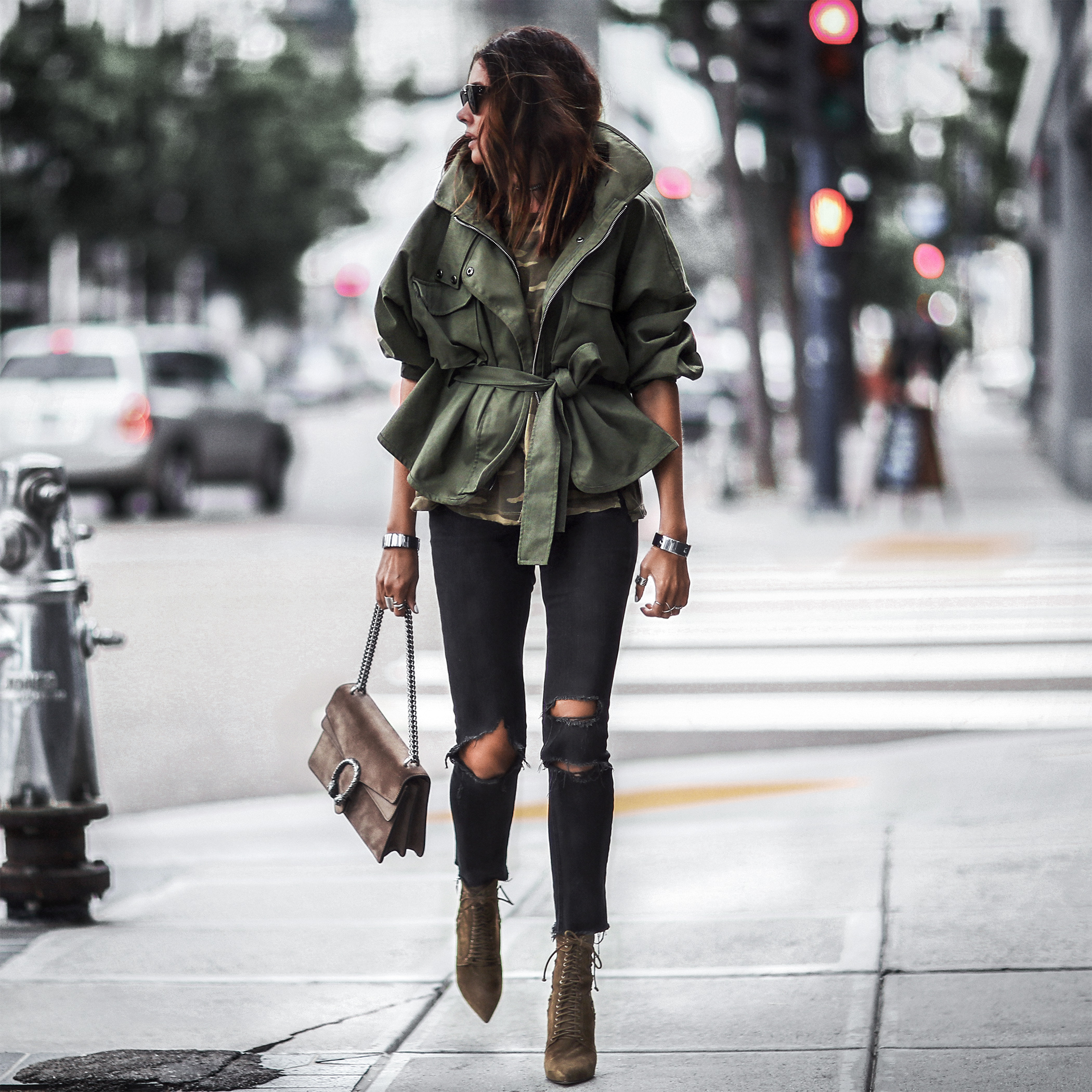 oversized army green jacket, camo tee, ripped skinny jeans, green lace up booties, gucci bag