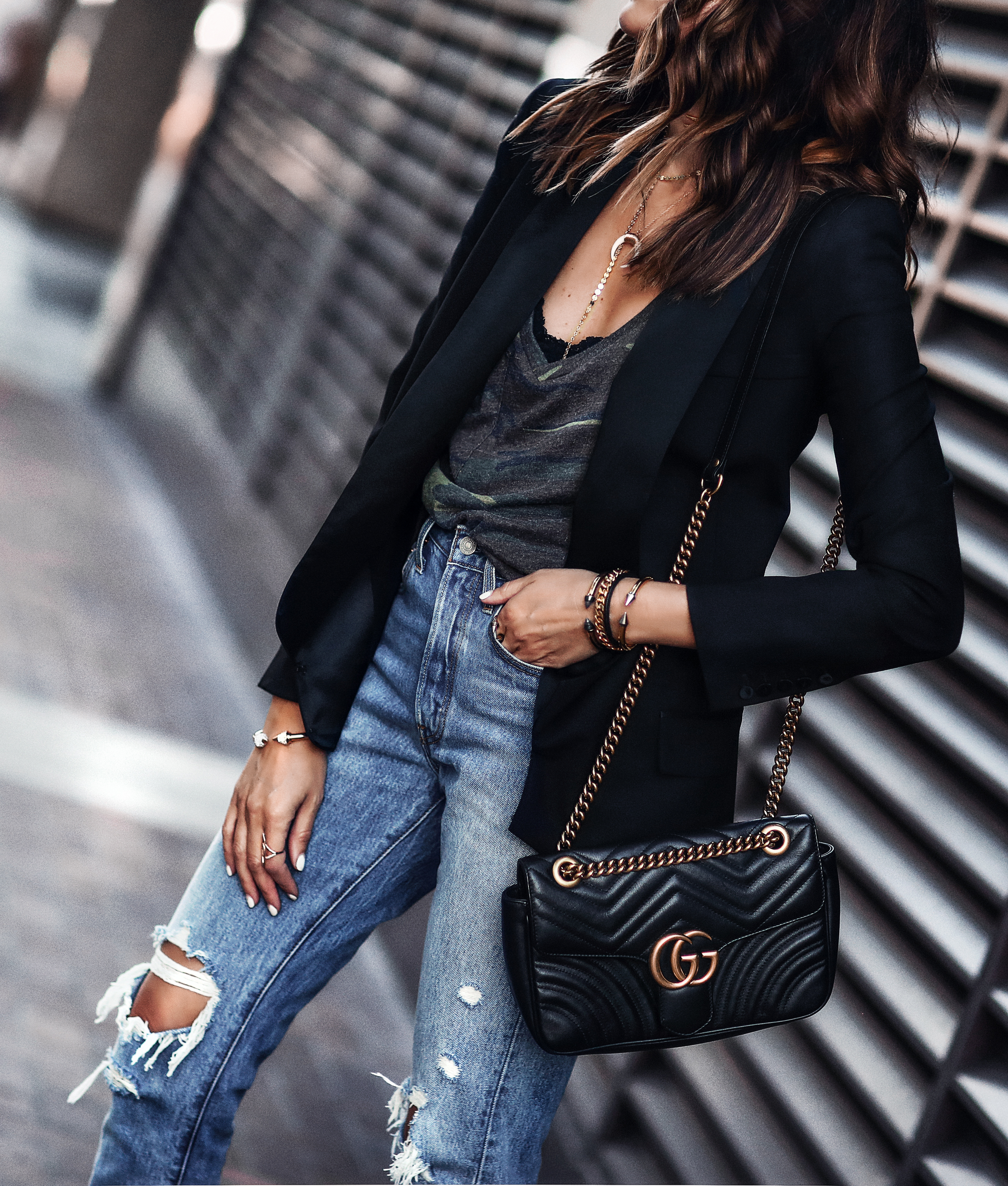 black blazer, camo tee, high waisted ripped jeans, gucci bag