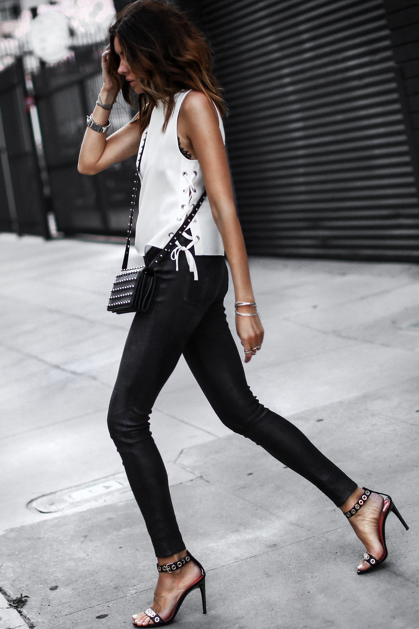 lace-up tank top, crossbody studded bag, black leather pants