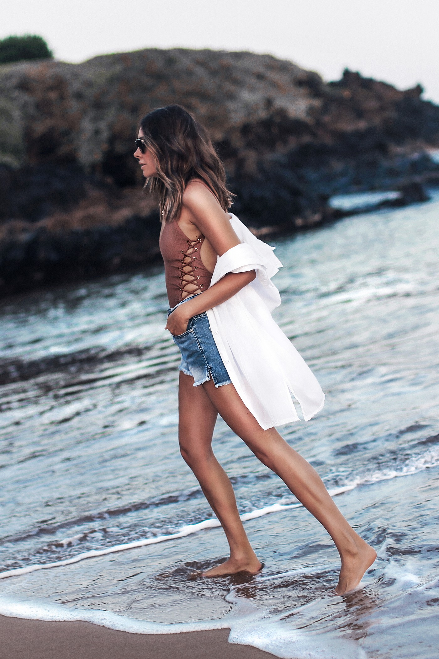 lace-up one piece swimsuit, high waisted jean shorts, white button up