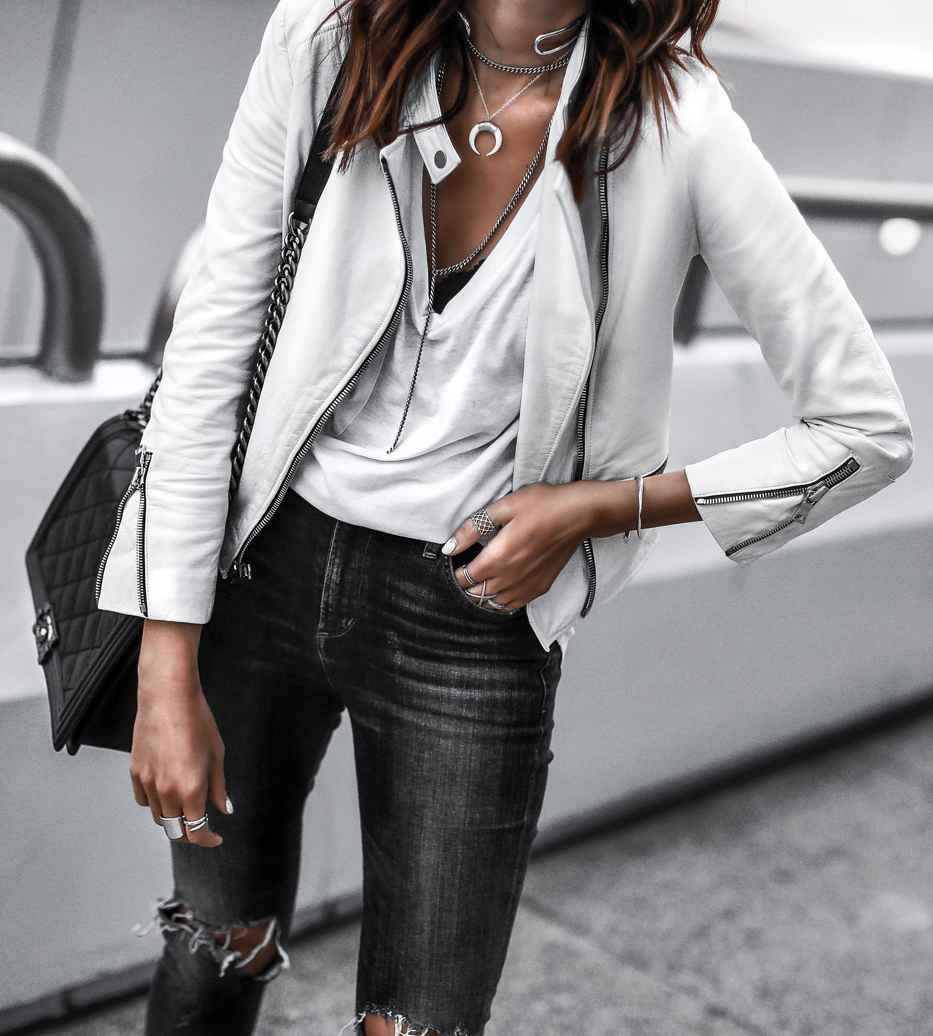 white leather jacket, white tee, layered necklaces, ripped skinny jeans, chanel bag