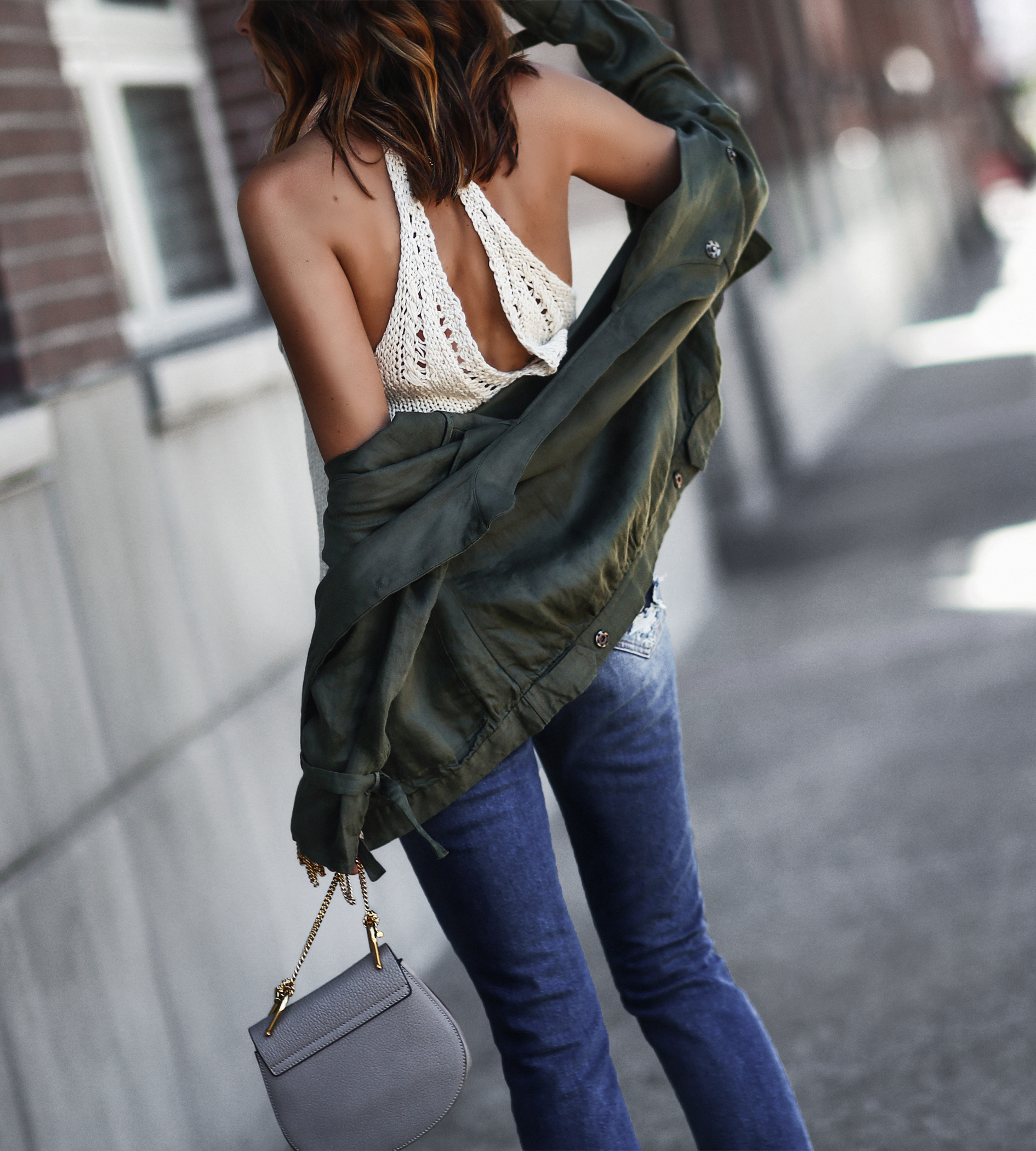 white knit tank top, army green jacket, distressed jeans