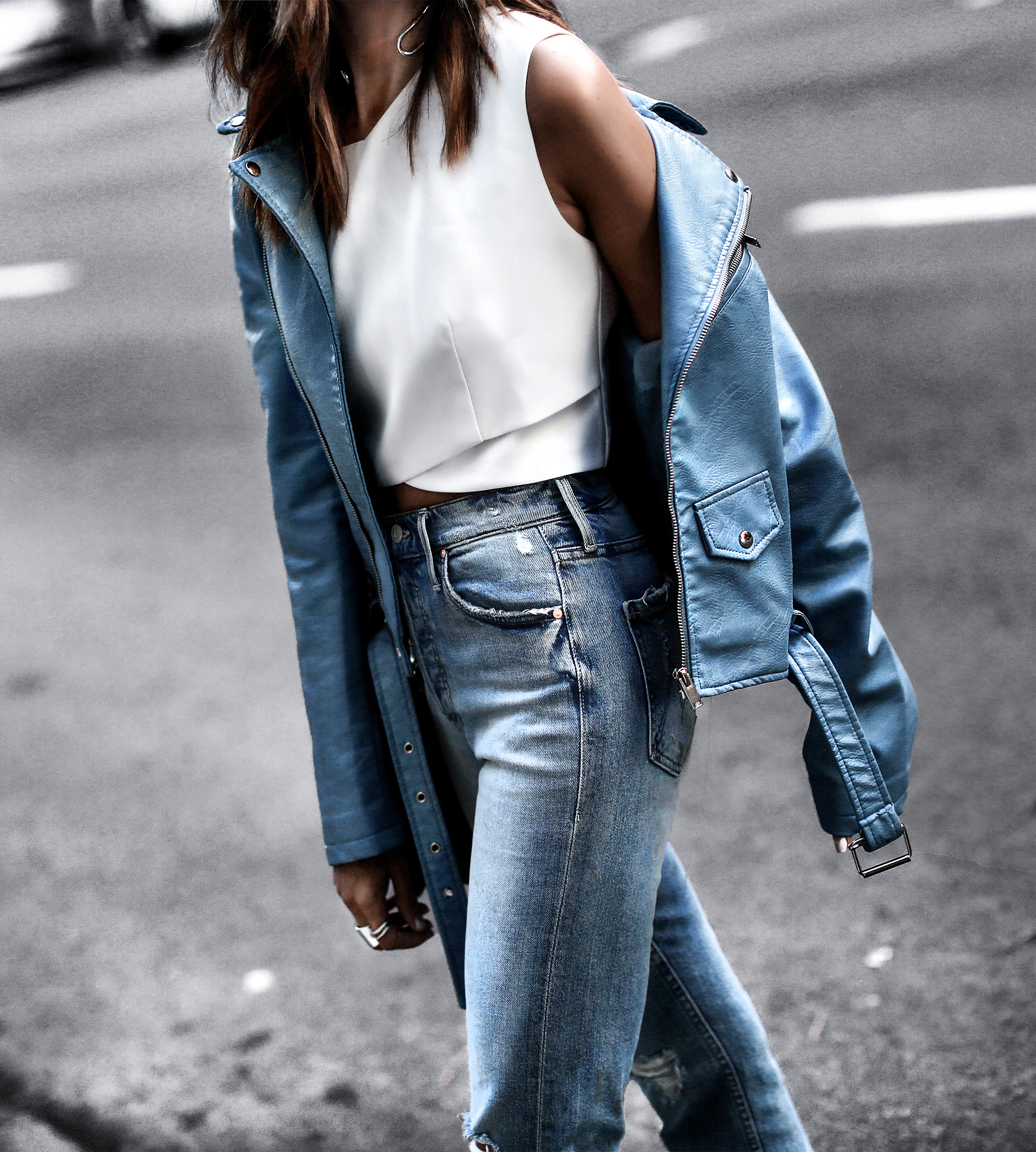 light blue leather jacket, high waisted mom jeans. white crop top