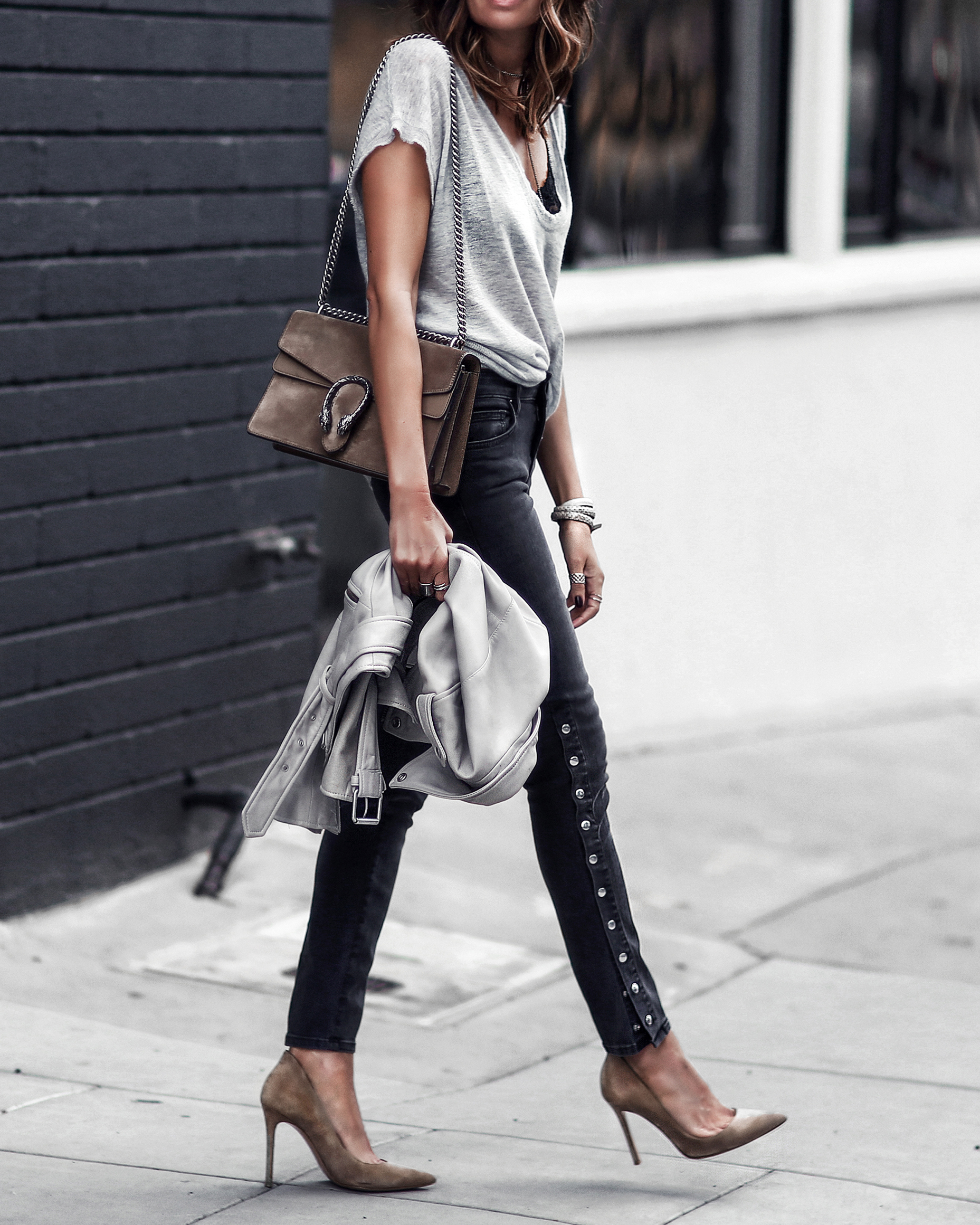 gray oversized knit tshirt, black lace bralette, faded black jeans with snaps, nude pumps, gray leather jacket, gucci bag