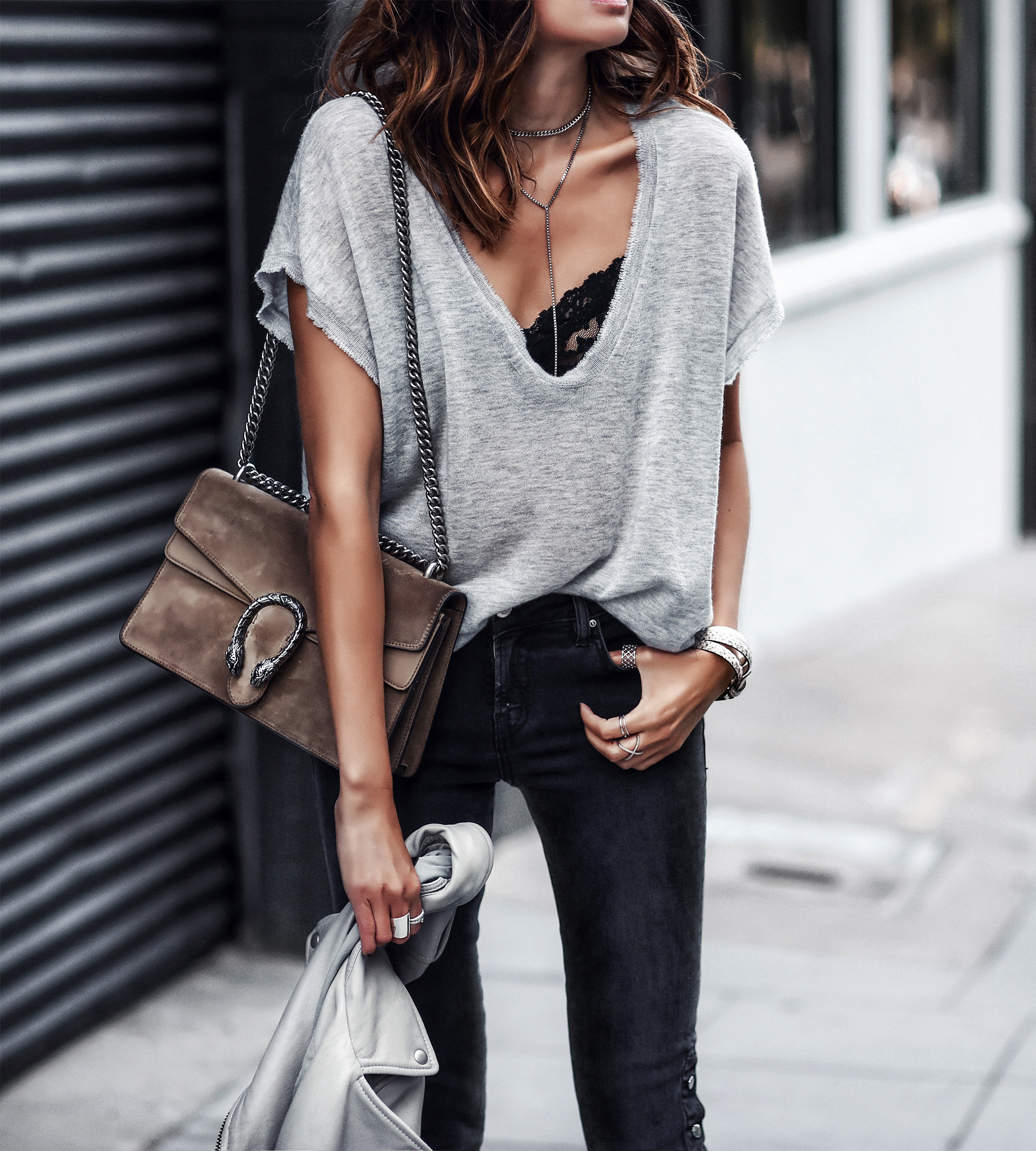 oversized gray tshirt, black lace bralette, black skinny jeans, gucci bag