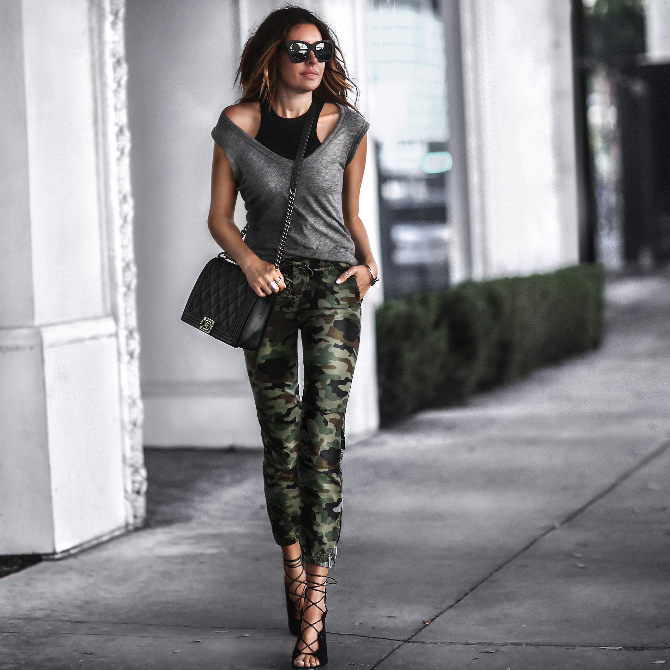 black ribbed tank top, grey v-neck tee, camo pants, lace up sandals, chanel bag
