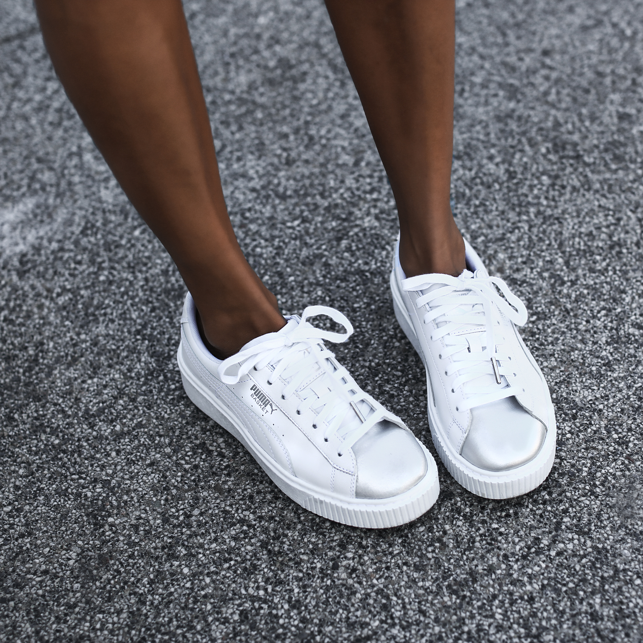white puma sneakers with silver