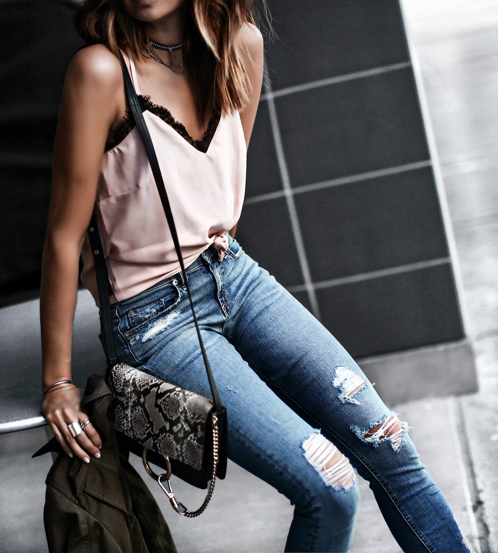 distressed raw hem jeans, army green jacket, light pink camisole, python print chloe bag