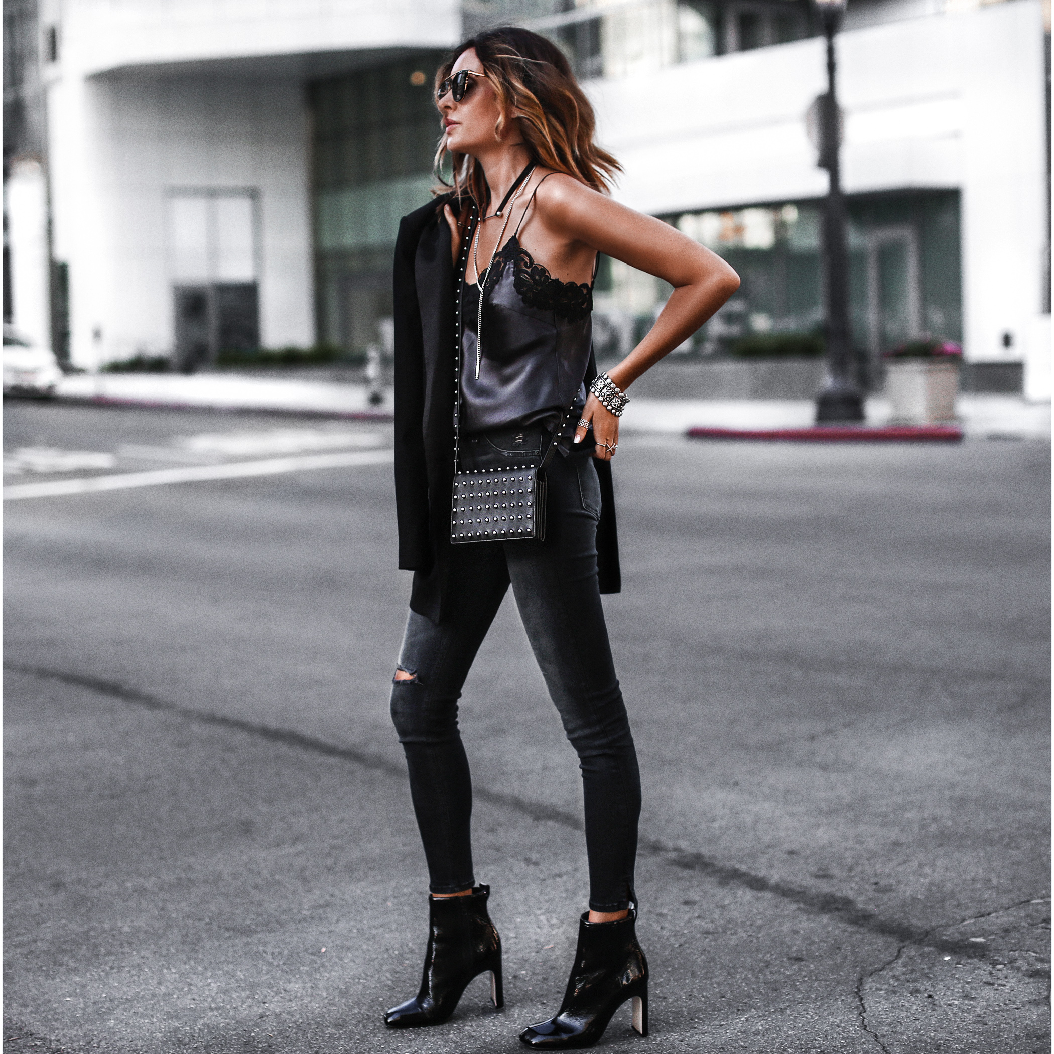 satin and lace cami, black skinny jeans, black blazer, patent leather booties, studded crossbody bag