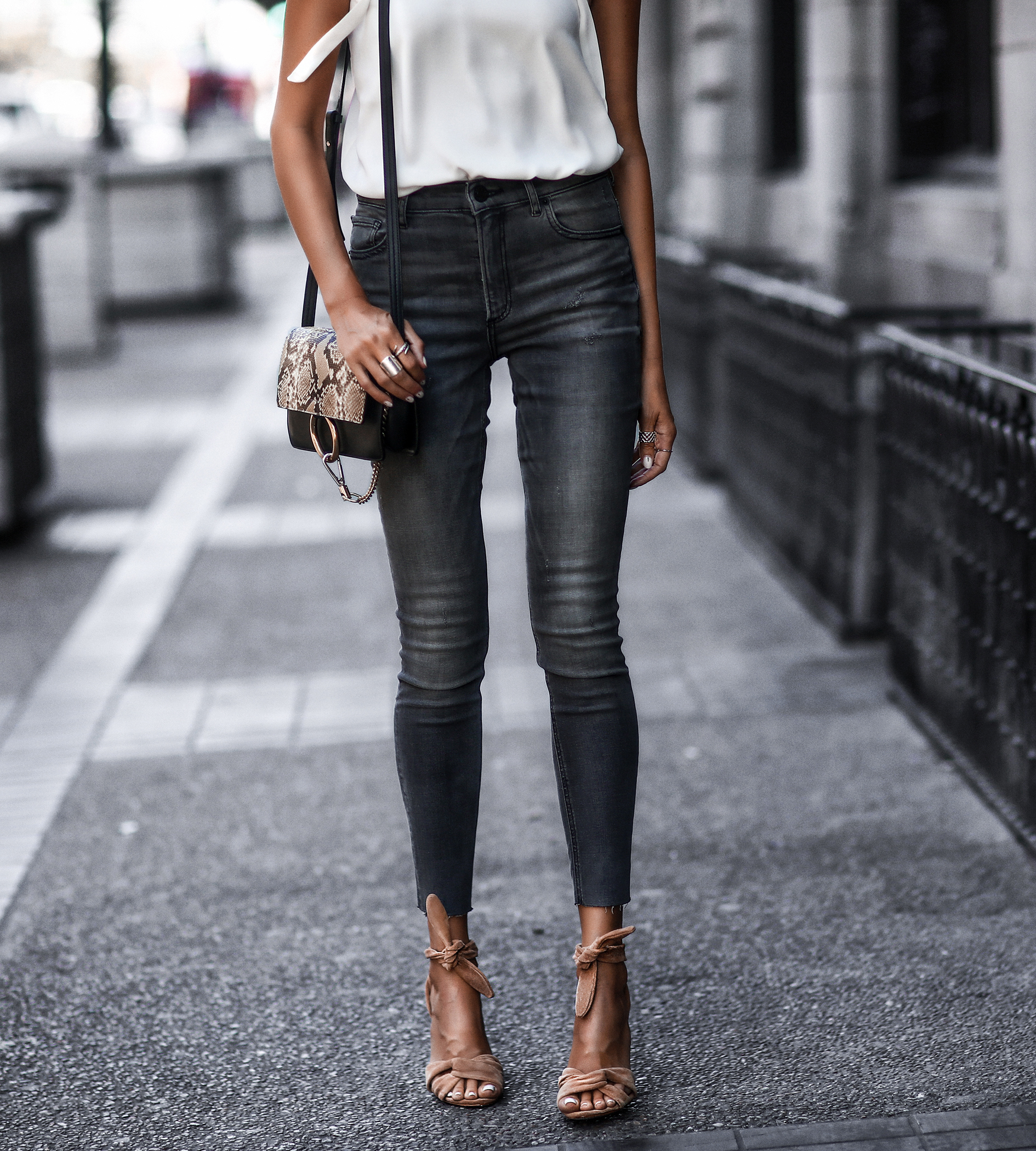 white silky camisole, raw hem grey skinny jeans, nude suede sandals, snake print chloe bag
