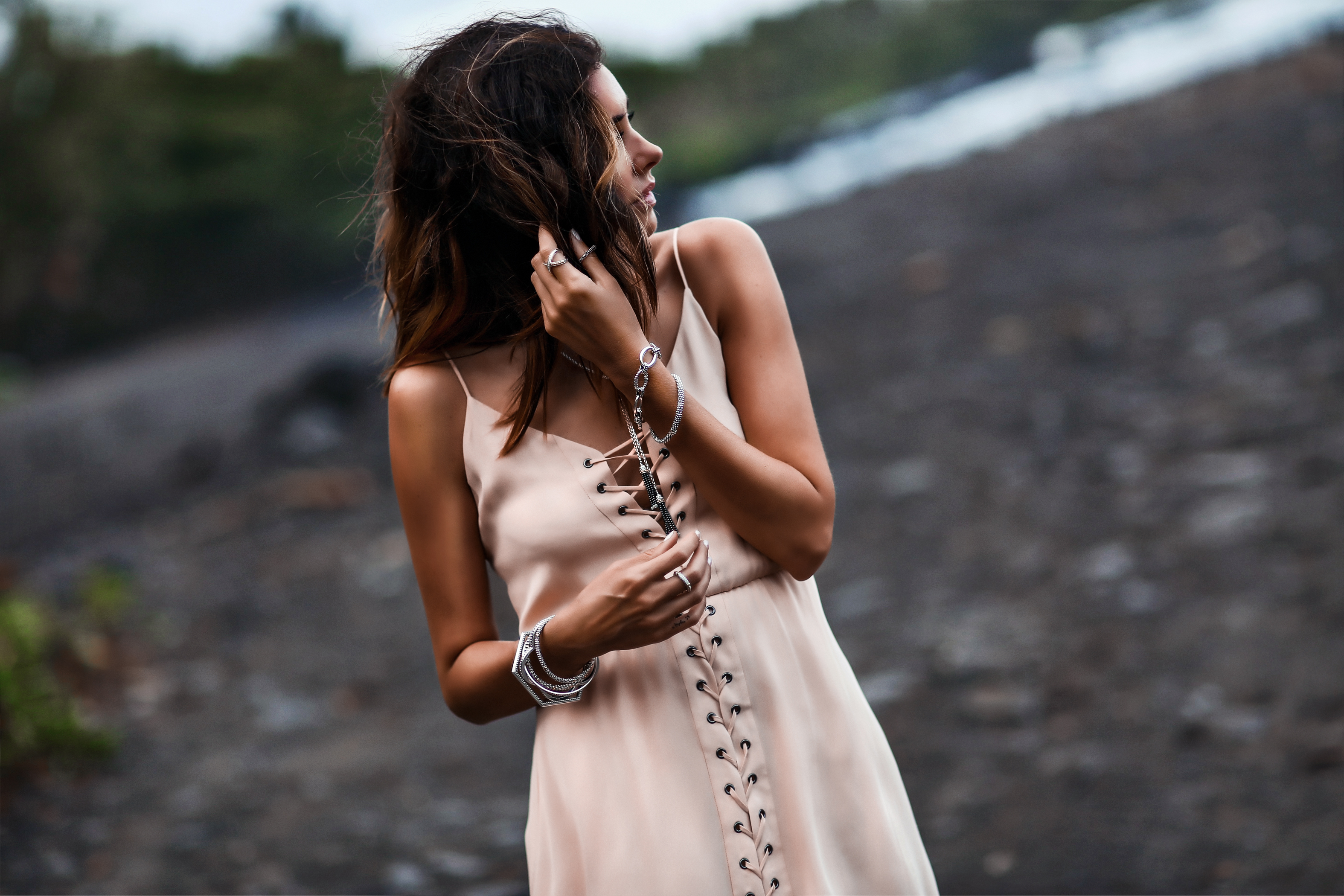 satin lace up maxi dress, stacked silver lagos bracelets and rings