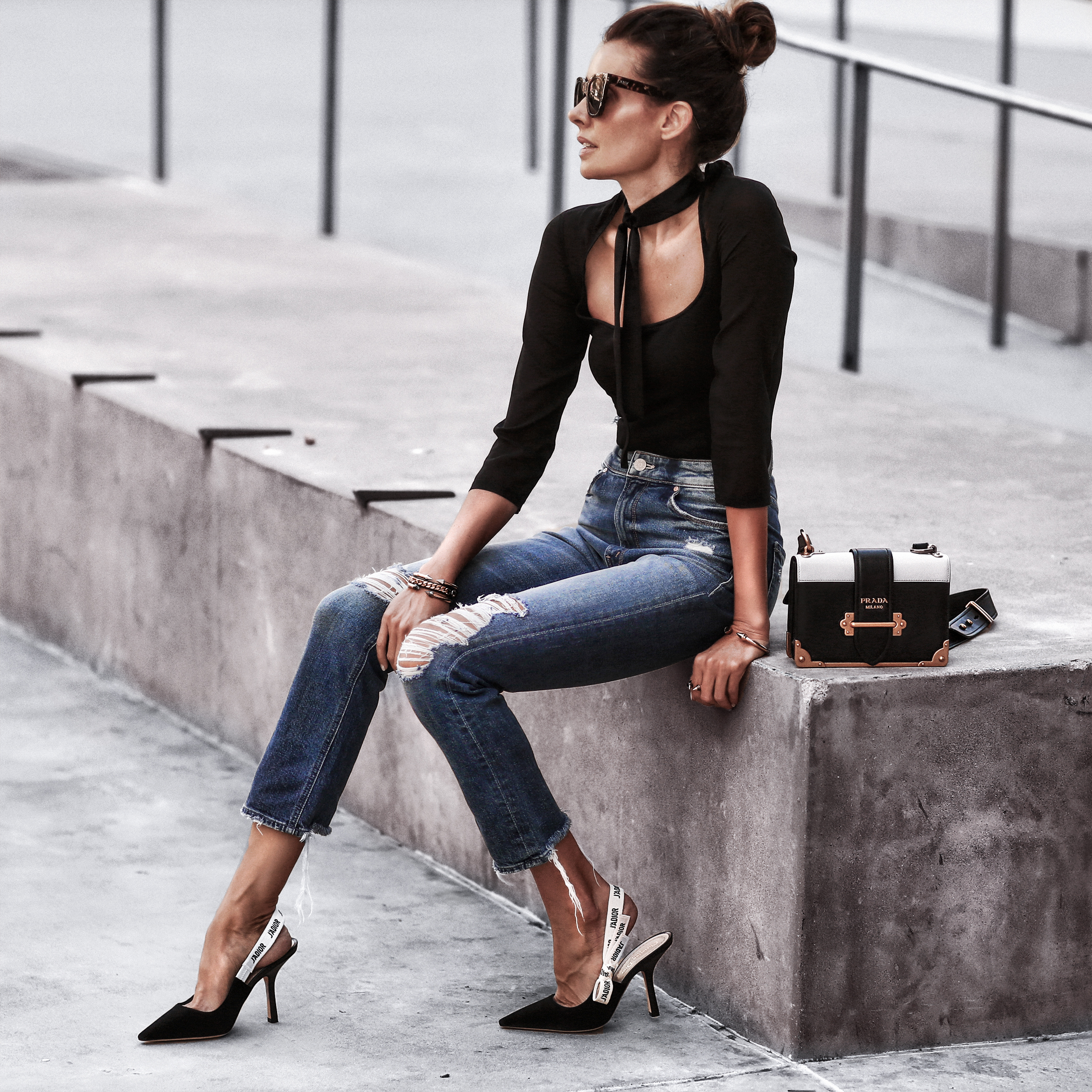 ballerina bodysuit with neck tie, high waisted distressed jeans, dior pumps, prada bag