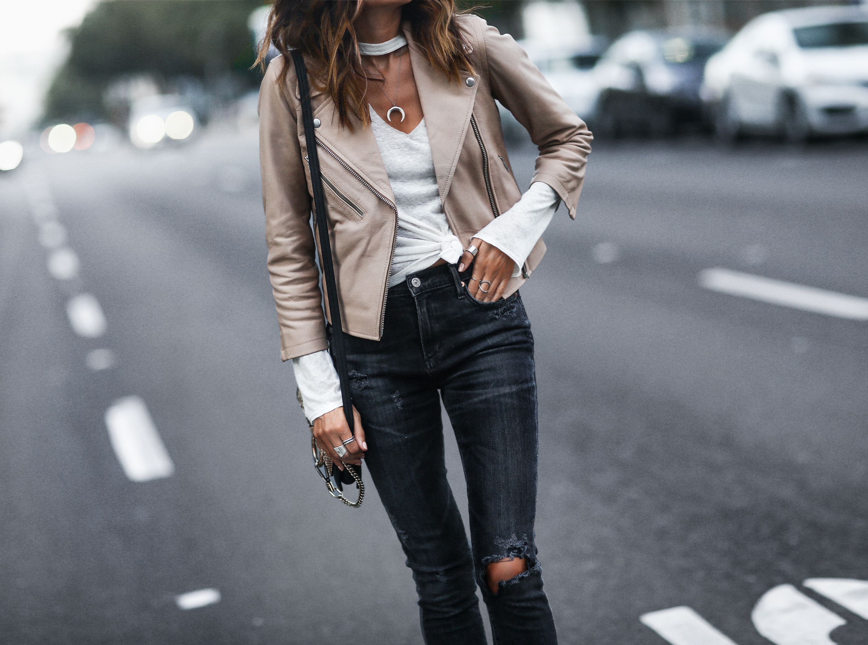 tan leather cropped moto jacket, white burn out long sleeve tee, black distressed skinny jeans