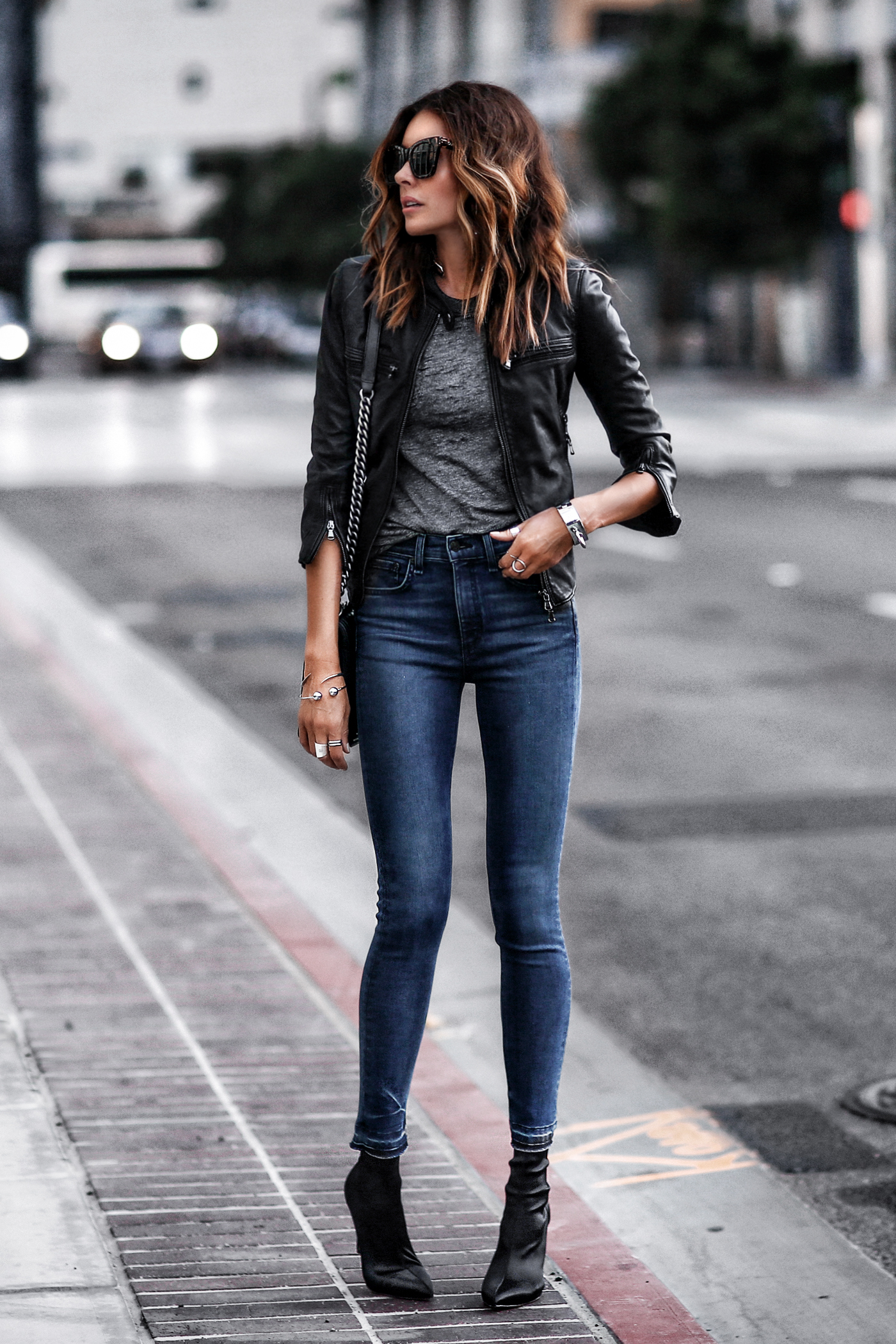 black leather cropped jacket, raw hem skinny jeans, grey burnout tee, black satin sock boots
