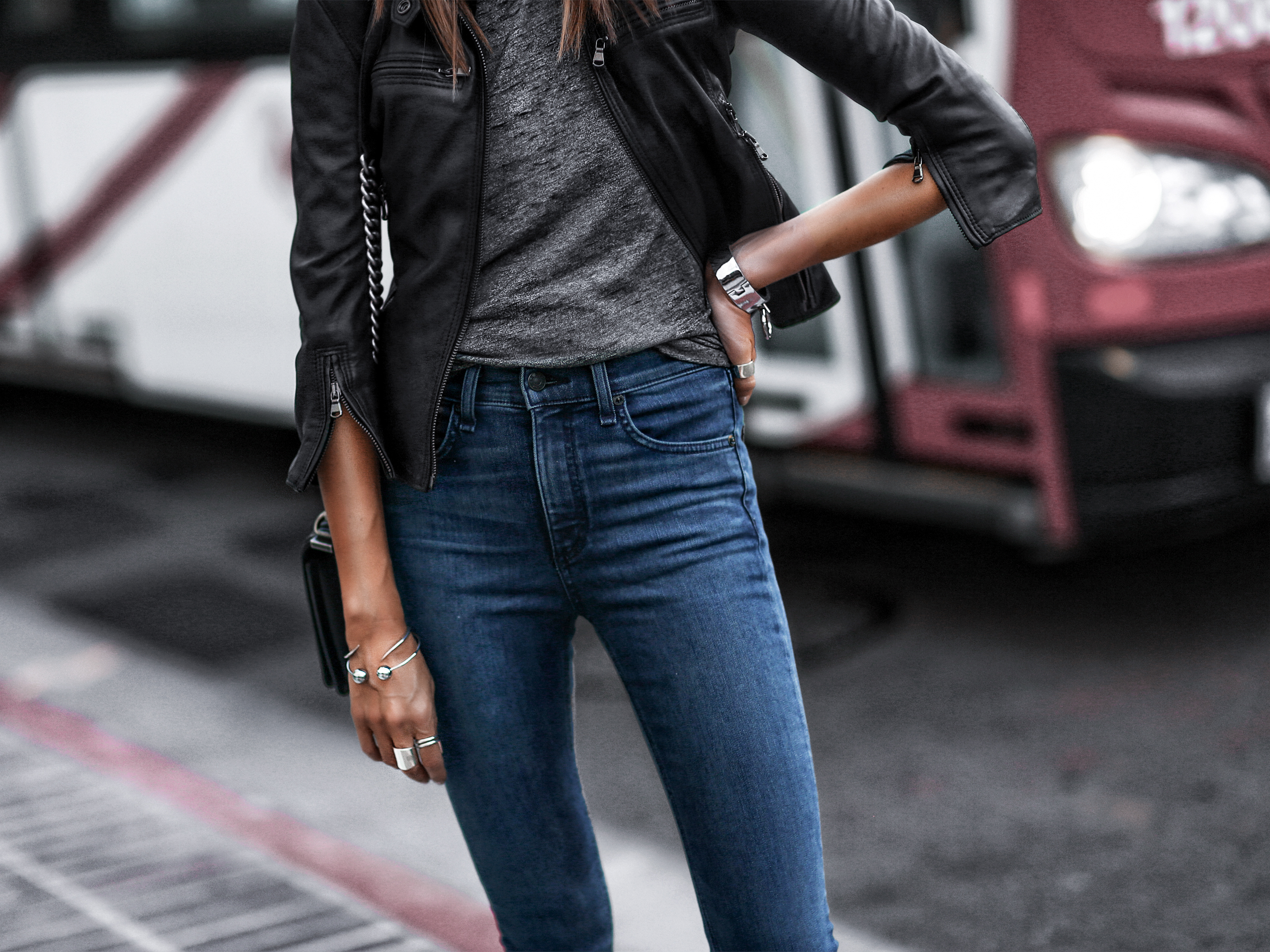 black leather cropped jacket, raw hem skinny jeans, grey burnout tee, chanel bag