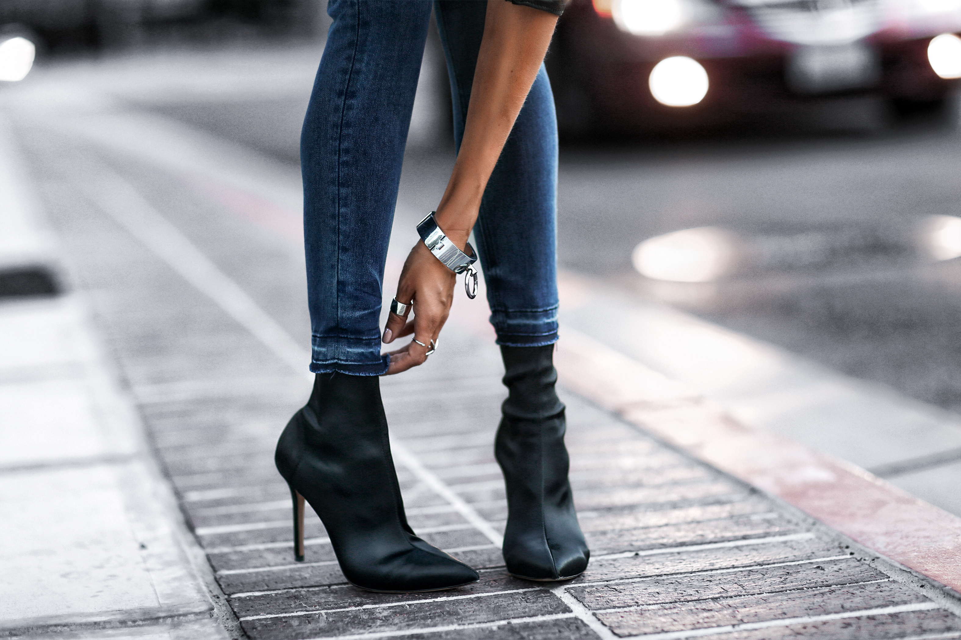 blue raw hem skinny jeans, black satin sock booties