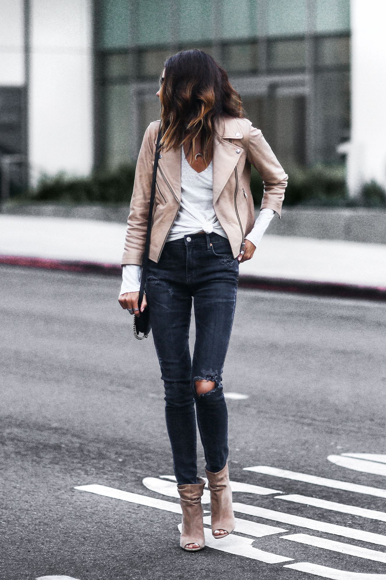 tan leather cropped moto jacket, white burn out long sleeve tee, black distressed skinny jeans, peep toe booties