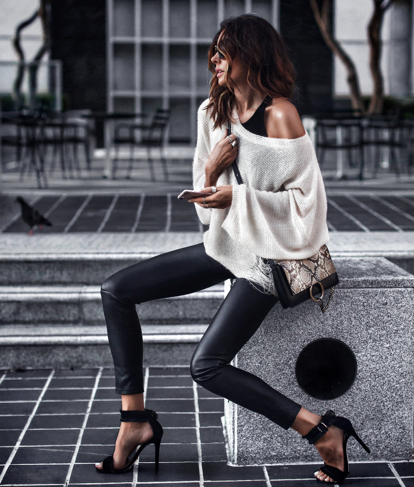 distressed sweater, off the shoulder, leather pants