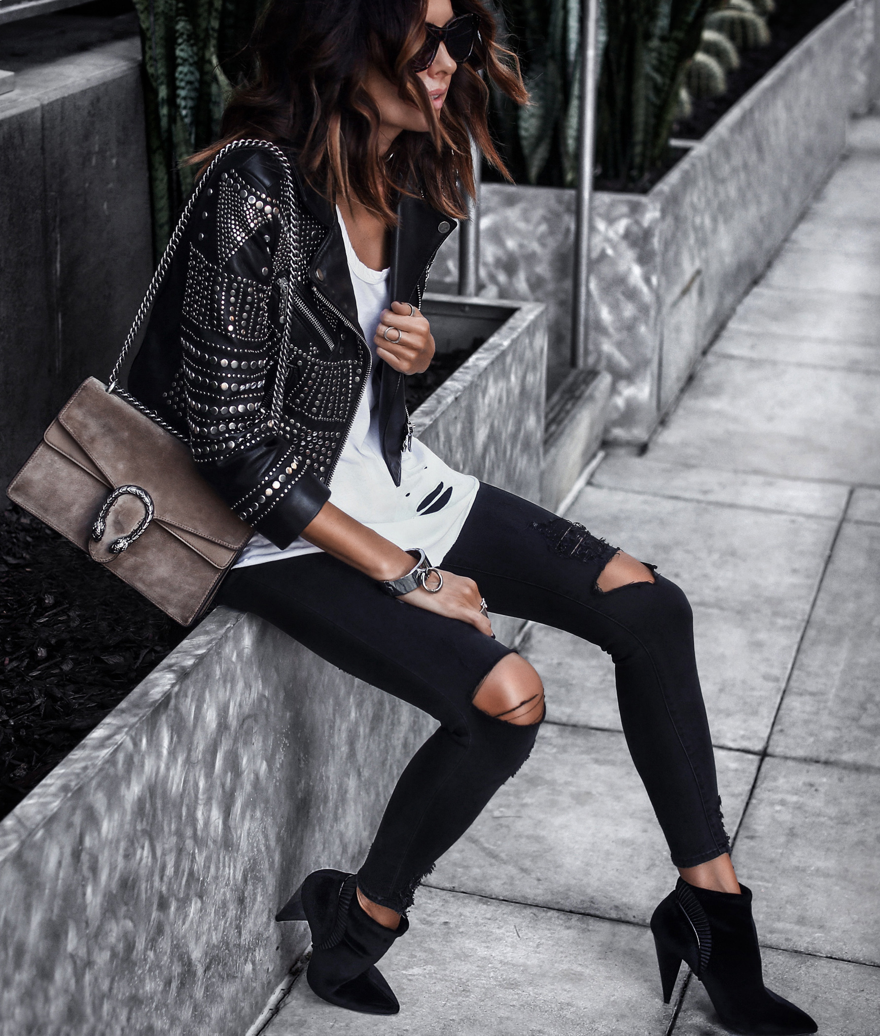 studded leather jacket, distressed tee and skinny jeans, velvet booties, gucci bag