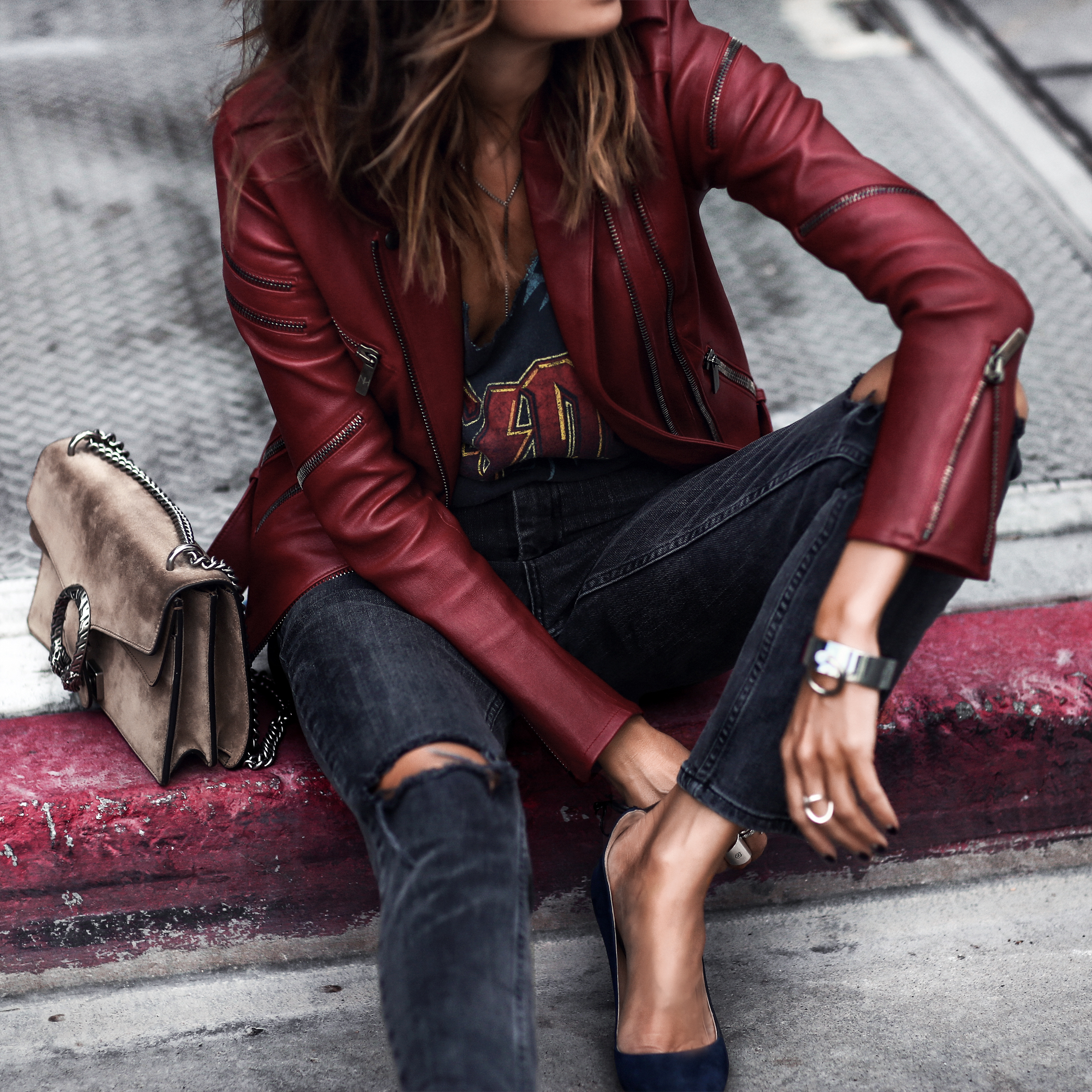 graphic tee, red leather jacket, ripped skinny jeans